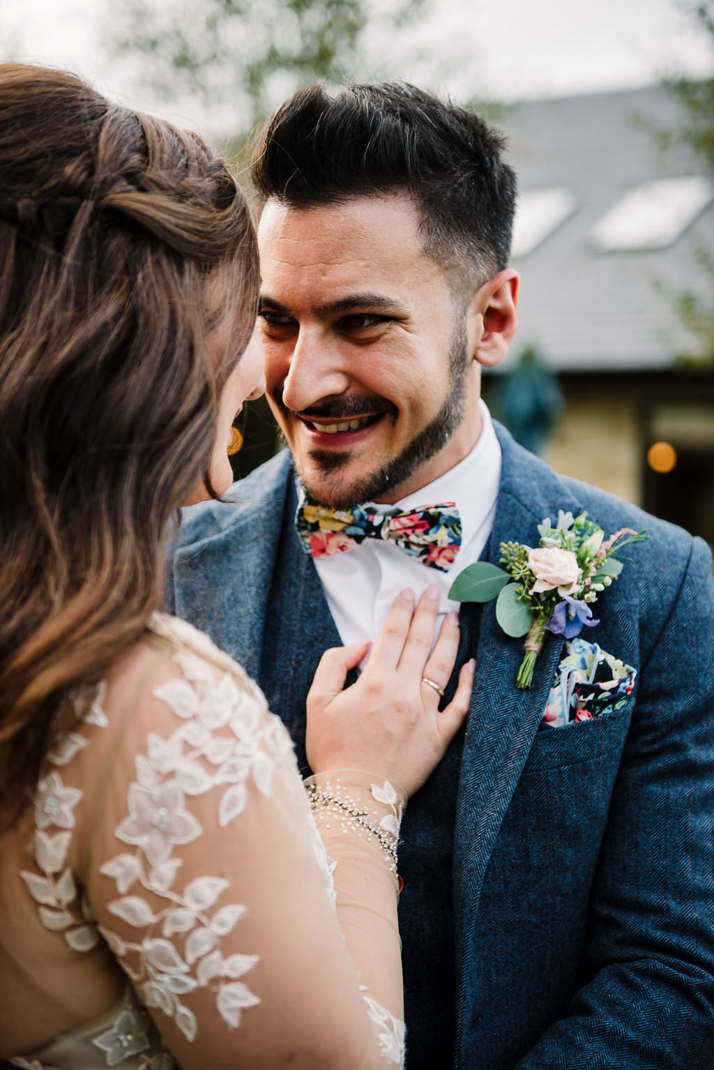 Colourful shot of grooms vintage style suit and button hole
