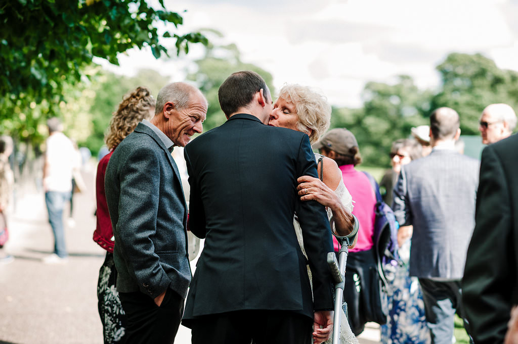 Wedding guests outside Yorkshire Sculpture Park