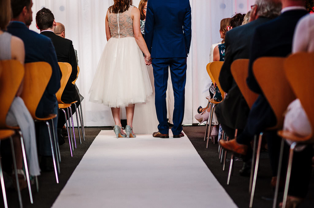 Detailed shot of bride and grooms wedding attire