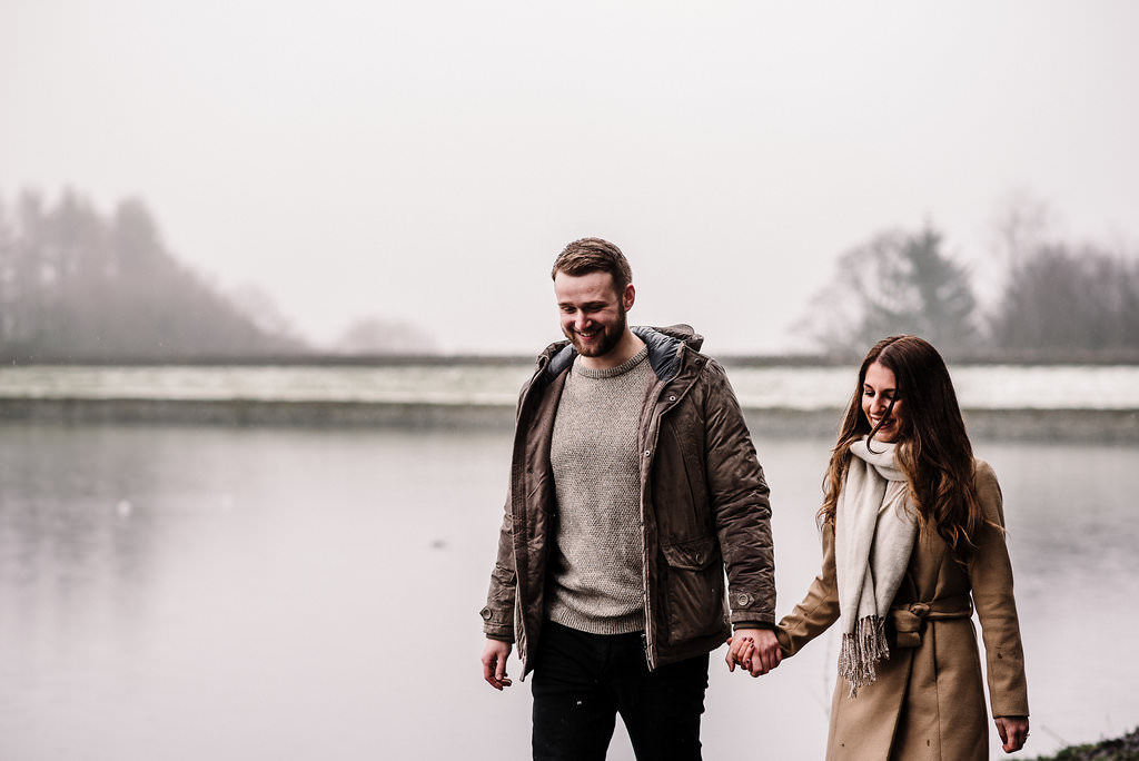 Couple walking together at Entwistle Res, Bolton.