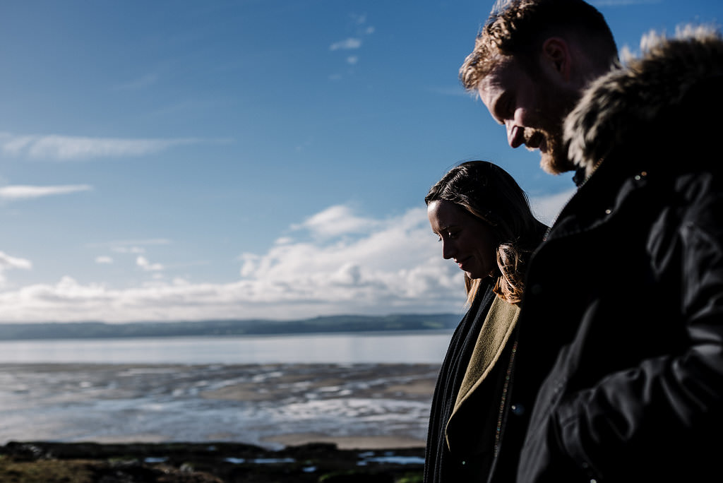 Silhouette of couple with views out to sea
