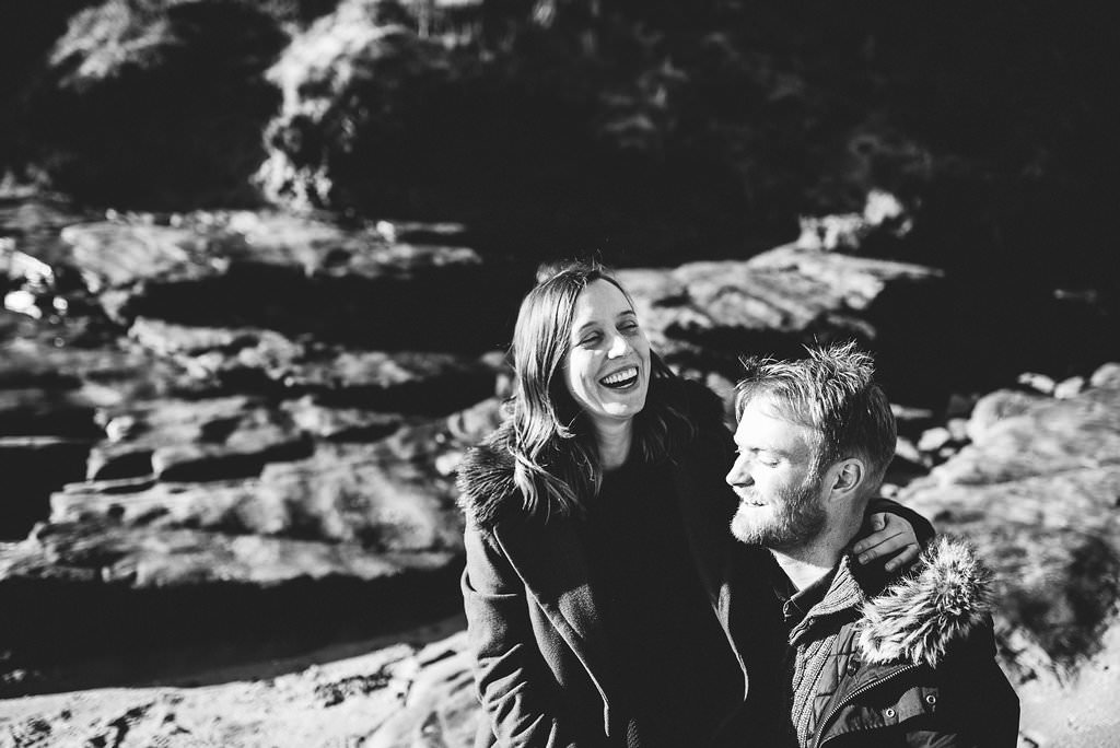 Black and white photo of bride to be laughing. Natural engagement photography