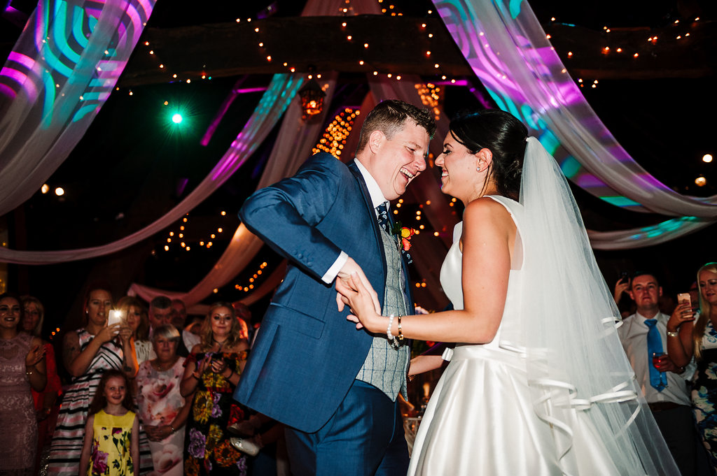 Colourful and fun photo of the bride and groom during their first dance at Rivington Hall Barn.