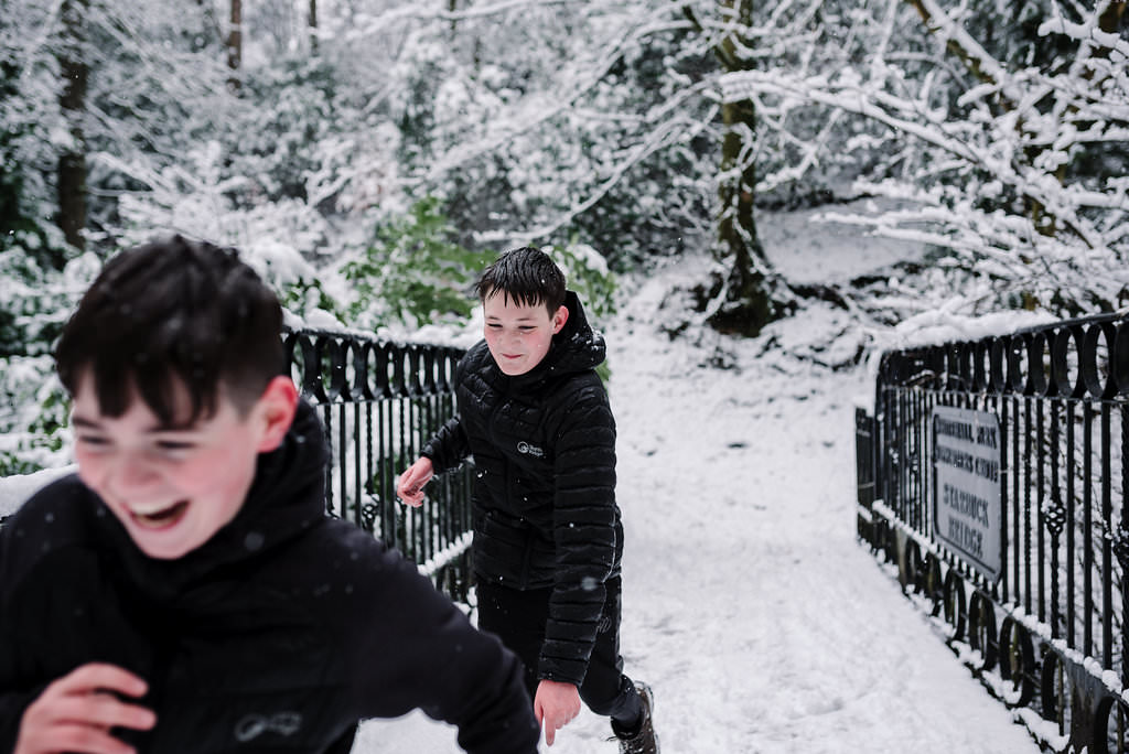 Snowball fight in the park. Natural photography Lancashire.