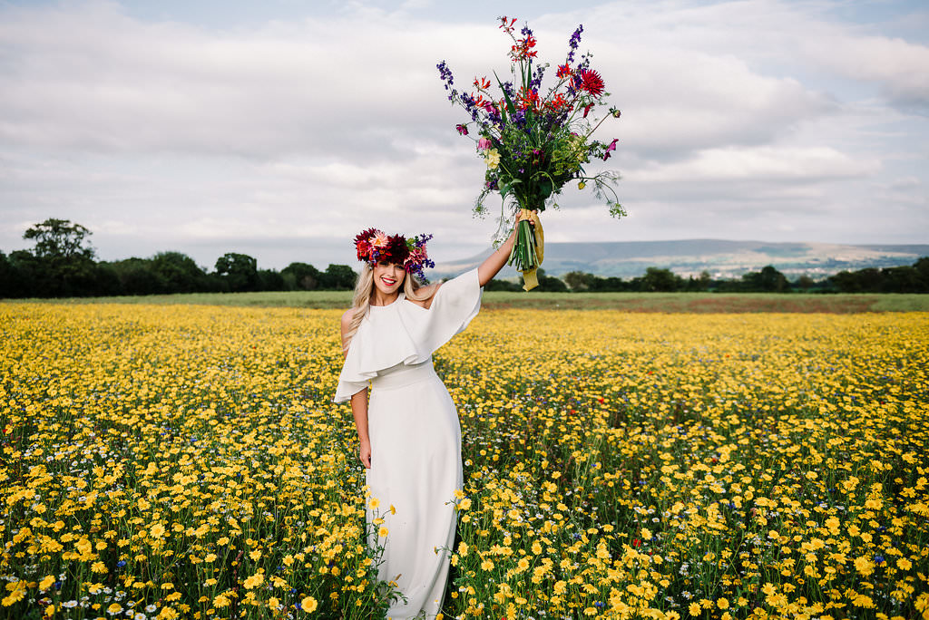 Bride in the yellow field at The Out Barn wedding venue in Clitheroe, Lancashire.