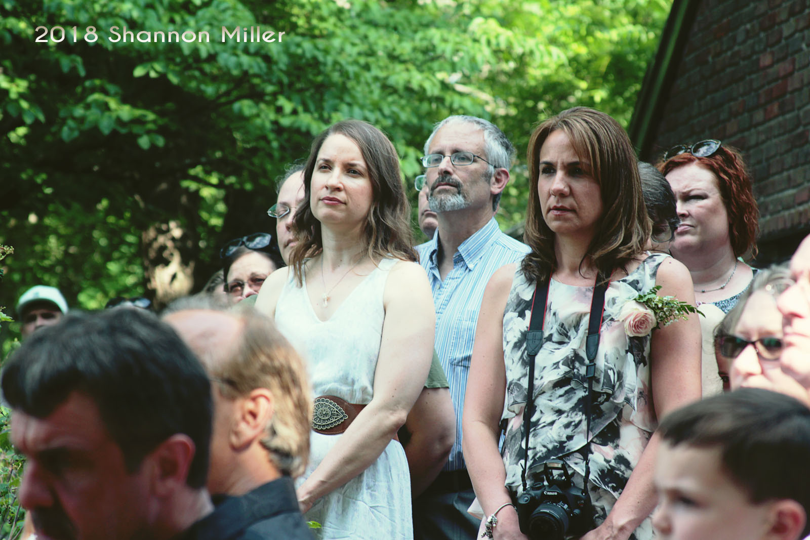 The audience listened intently to the couple's vows