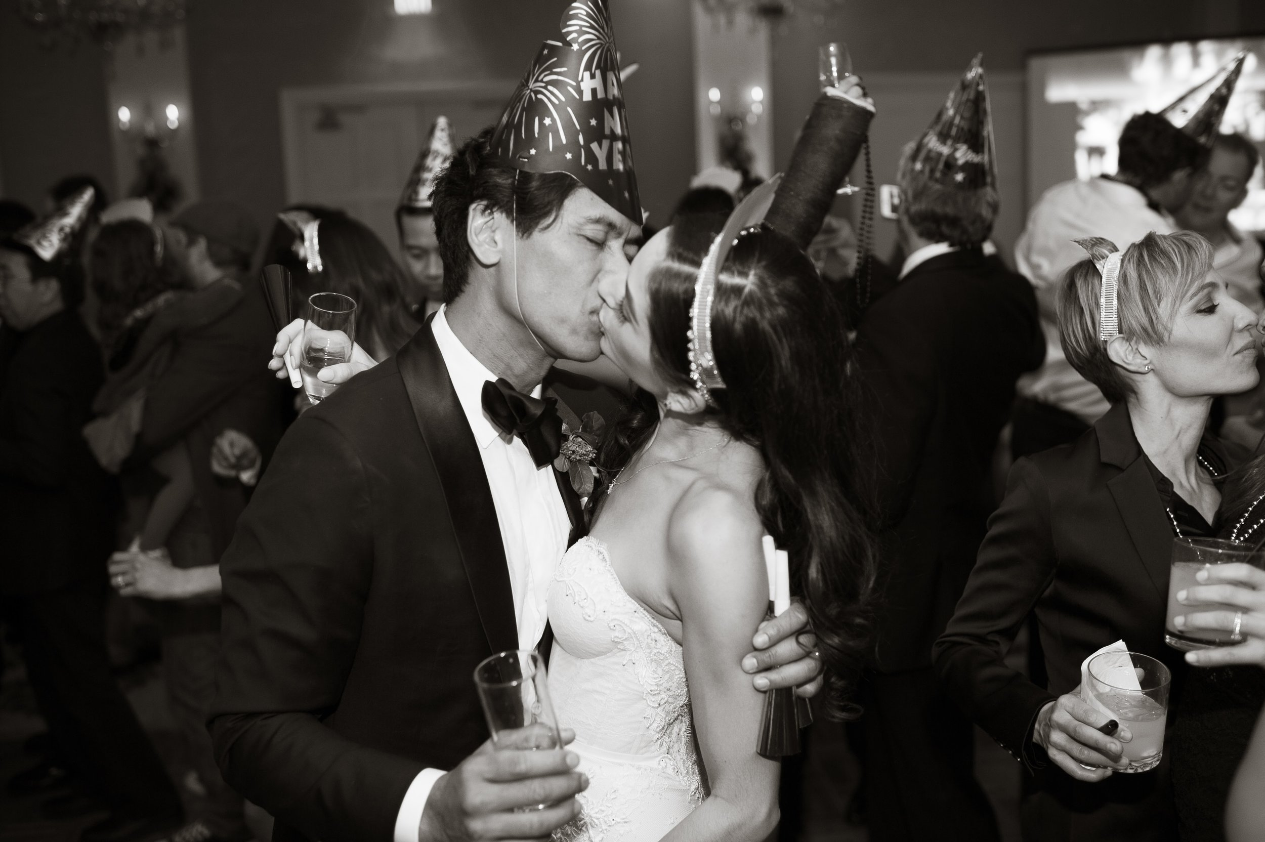www.santabarbarawedding.com | New Years Eve Wedding | Nate and Jenny | Felici Events | Belmond El Encanto | Black and White | Bride and Groom Kiss