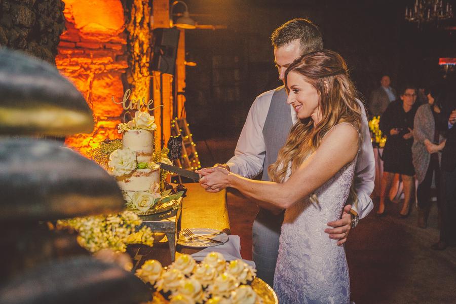 www.santabarbarawedding.com | Kramer Events | Santa Margarita Ranch | Bride and Groom | Cutting the Cake