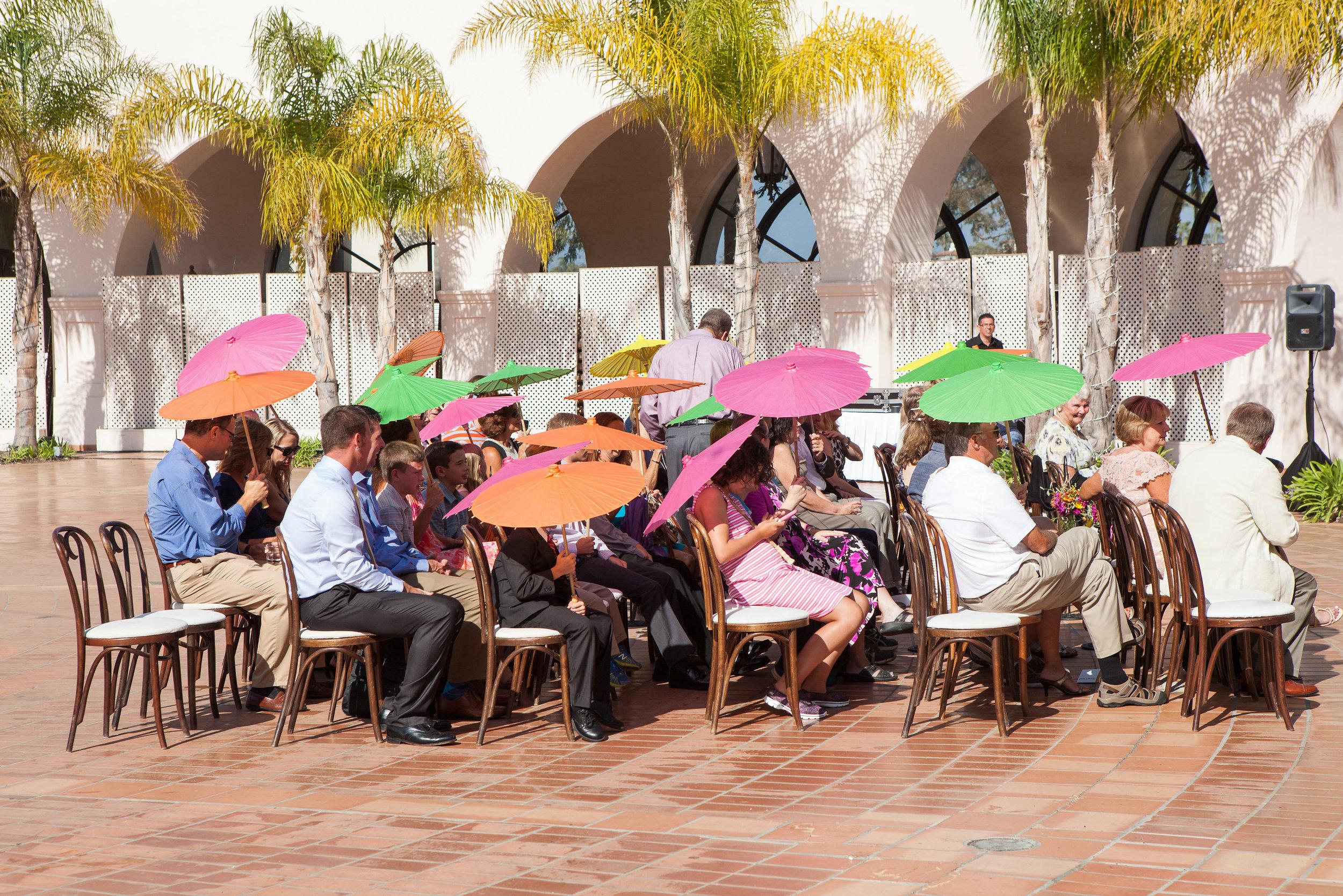 www.santabarbarawedding.com | fess parker resort | wedding ceremony | colorful parasols | Bijoux Events