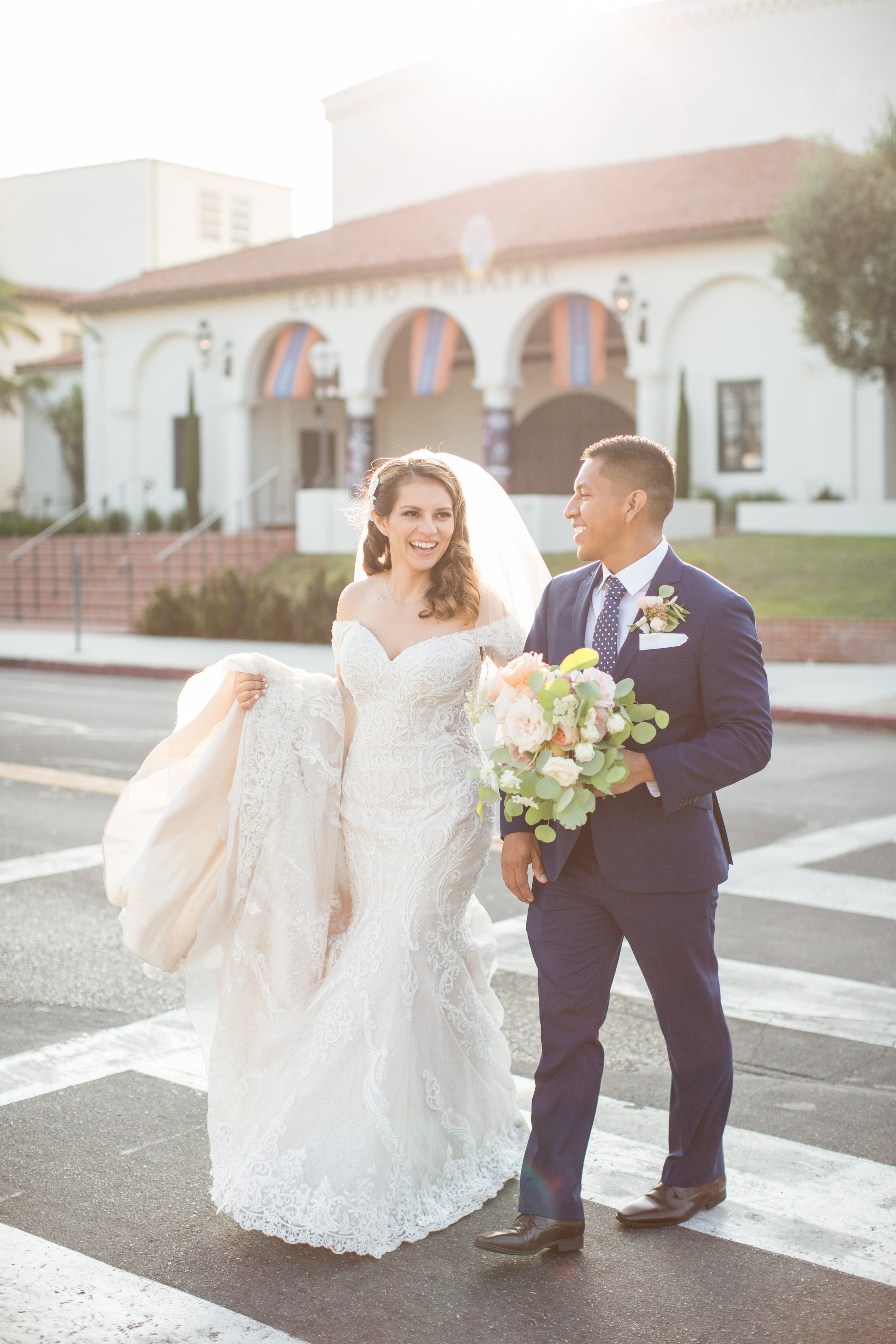 www.santbarbarawedding.com | Anna J Photography | Santa Barbara Courthouse | Selena Marie Weddings & Events for Wedding Planning | Bride and Groom Taking a Stroll