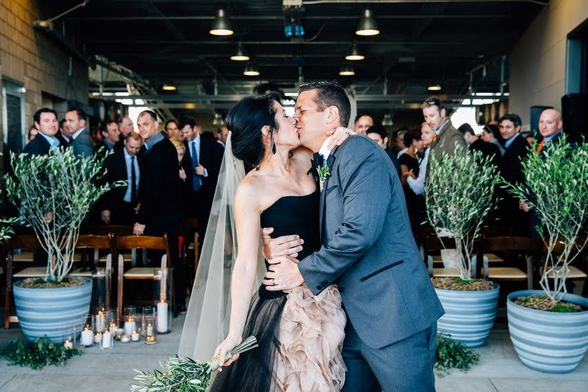 www.santabarabawedding.com | Photographer: Michael Stephens Photography | Venue: Presqu'ile Winery | Wedding Planner: Korinna Peterson of Le Festin Events | Bride & Groom Kiss