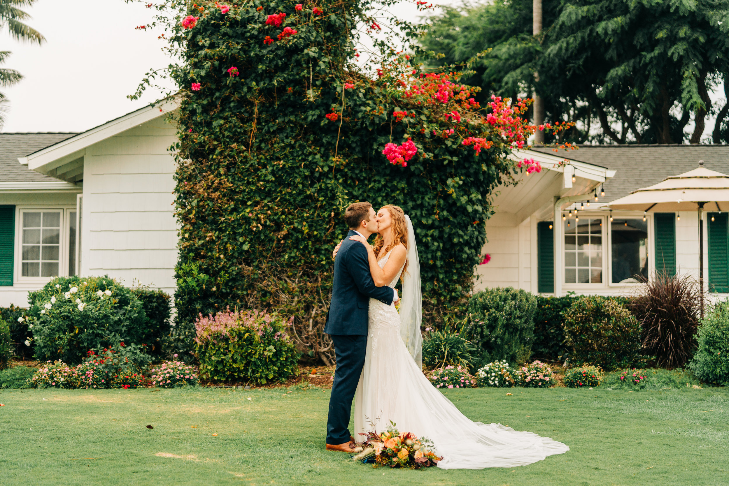 www.santabarbarawedding.com | Brandon Bibbins Photography | The Cottages at Polo Run | Christina Welch Floral | Couple Shares Kiss