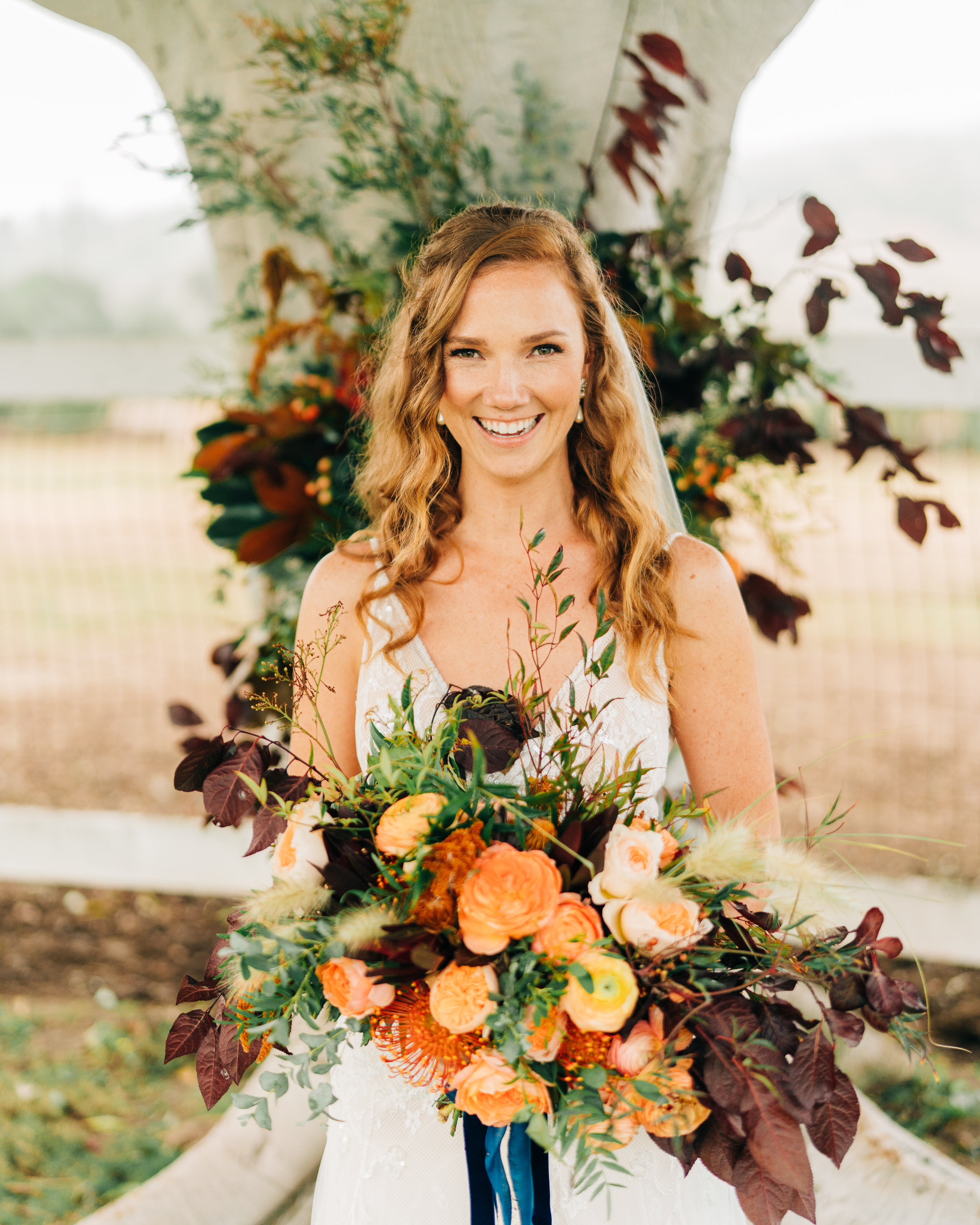 www.santabarbarawedding.com | Brandon Bibbins Photography | The Cottages at Polo Run | Christina Welch Floral | Bride Holds Bouquet