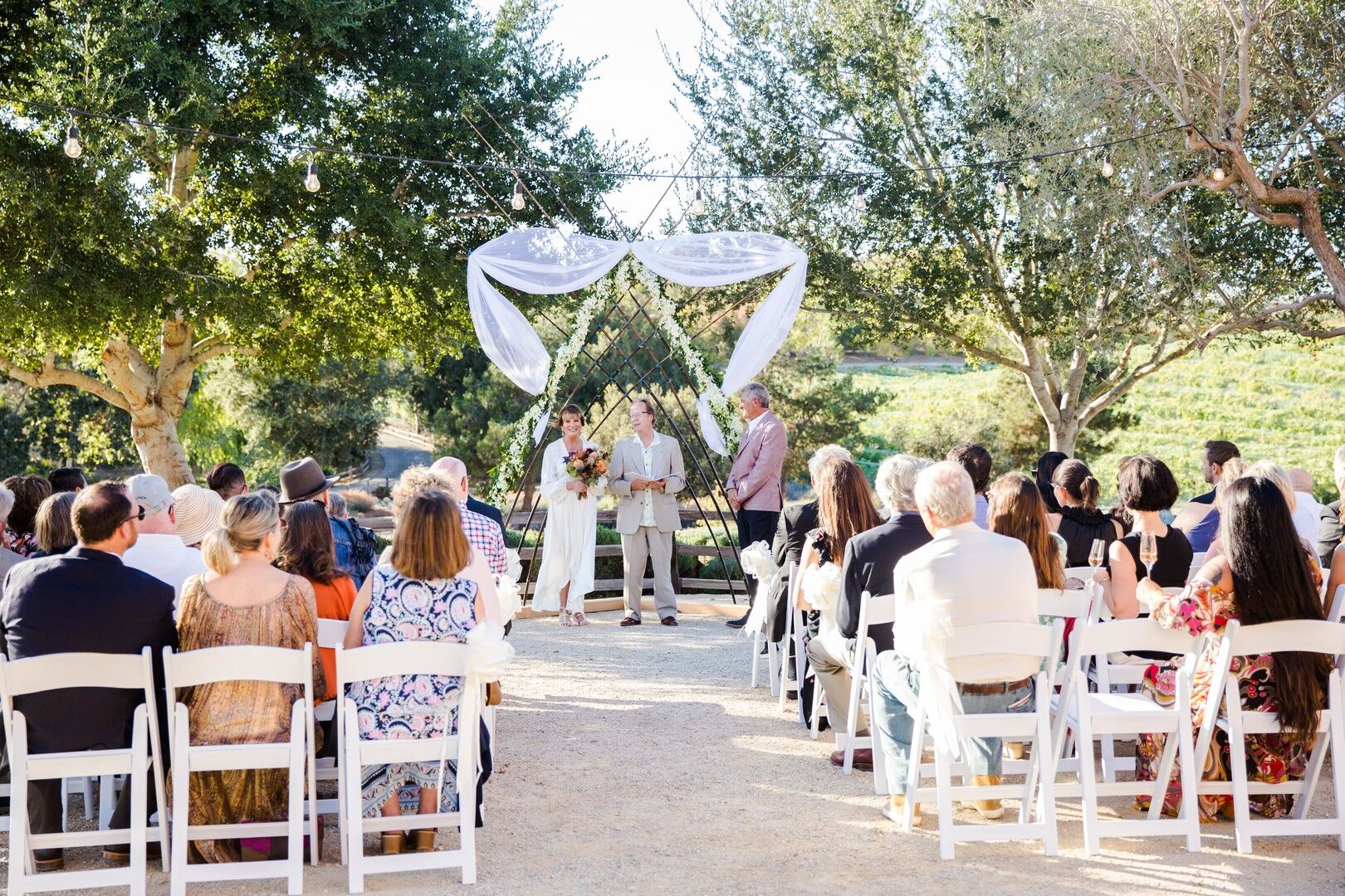 www.santabarbarawedding.com | Venue: Firestone Vineyard | Photographer: Just Kiss Collective | Wedding Dress: BHLDN | Wedding Ceremony