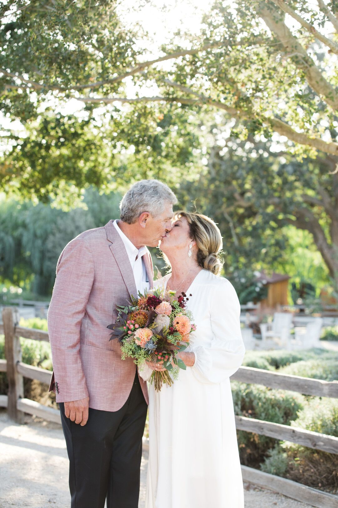 www.santabarbarawedding.com | Venue: Firestone Vineyard | Photographer: Just Kiss Collective | Bride and Groom Kiss