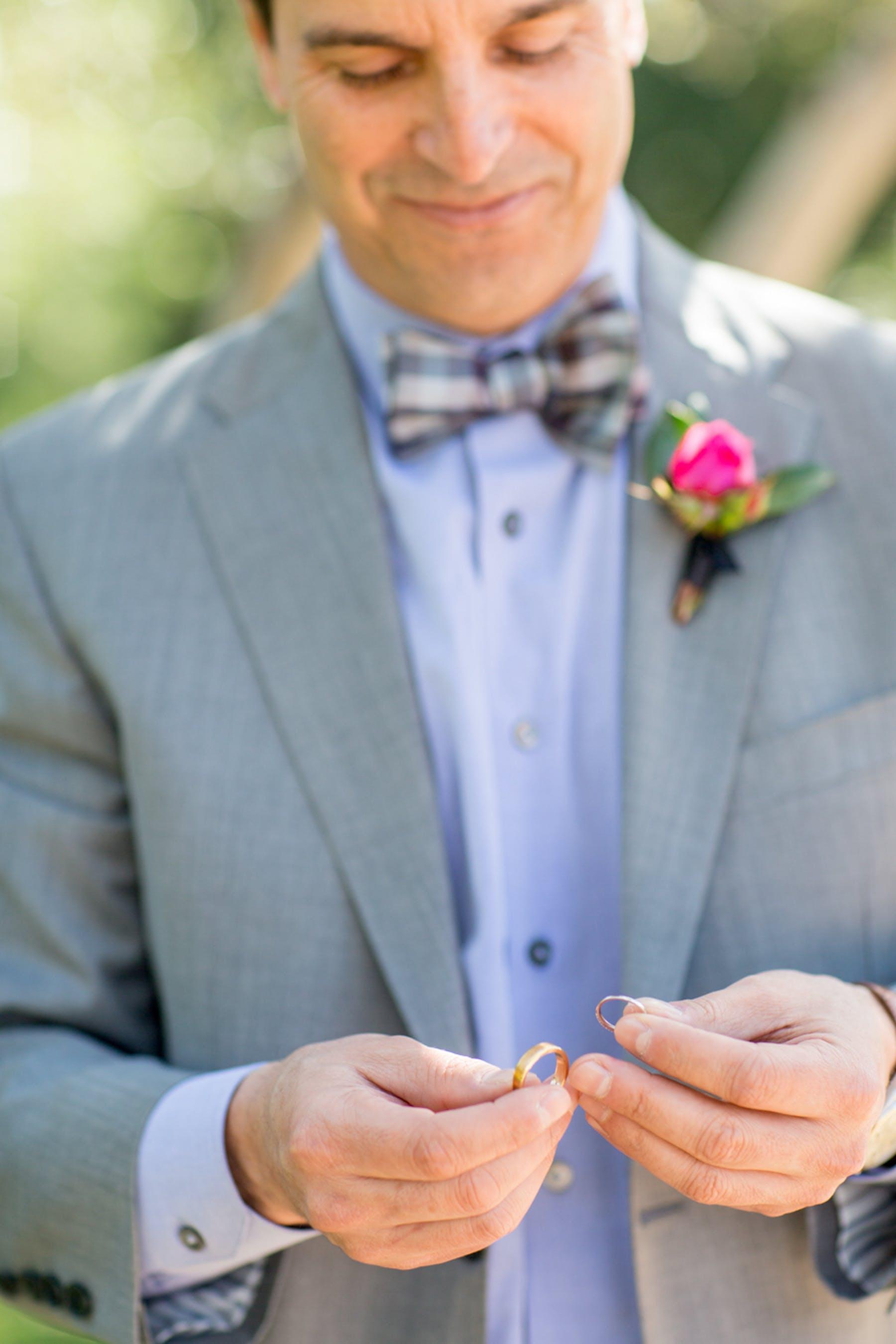 www.santabarbarawedding.com | Michael + Anna Costa Photography | San Ysidro Ranch | Twine Events | Ermenegildo Zegna | Groom Admires Rings