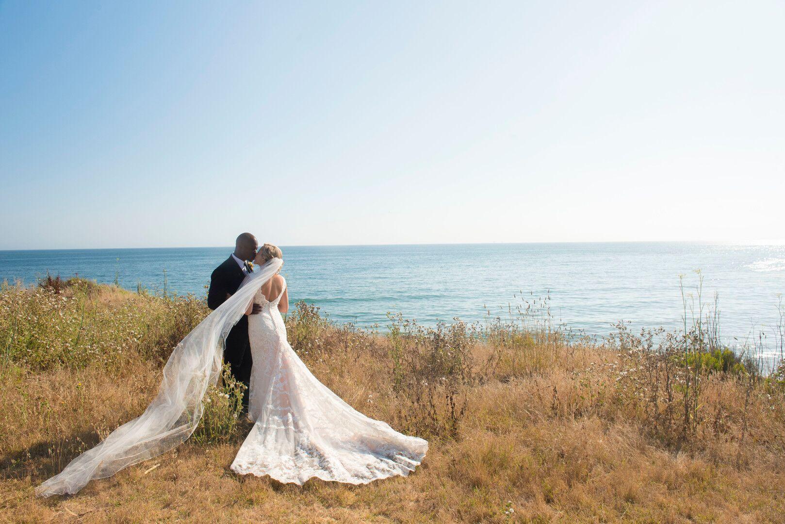 www.santabarbarawedding.com | Venue: Dos Pueblos Ranch | Photographer: ByCherry Photography | Event Designer: Elan Event Rentals | Bride and Groom Kiss