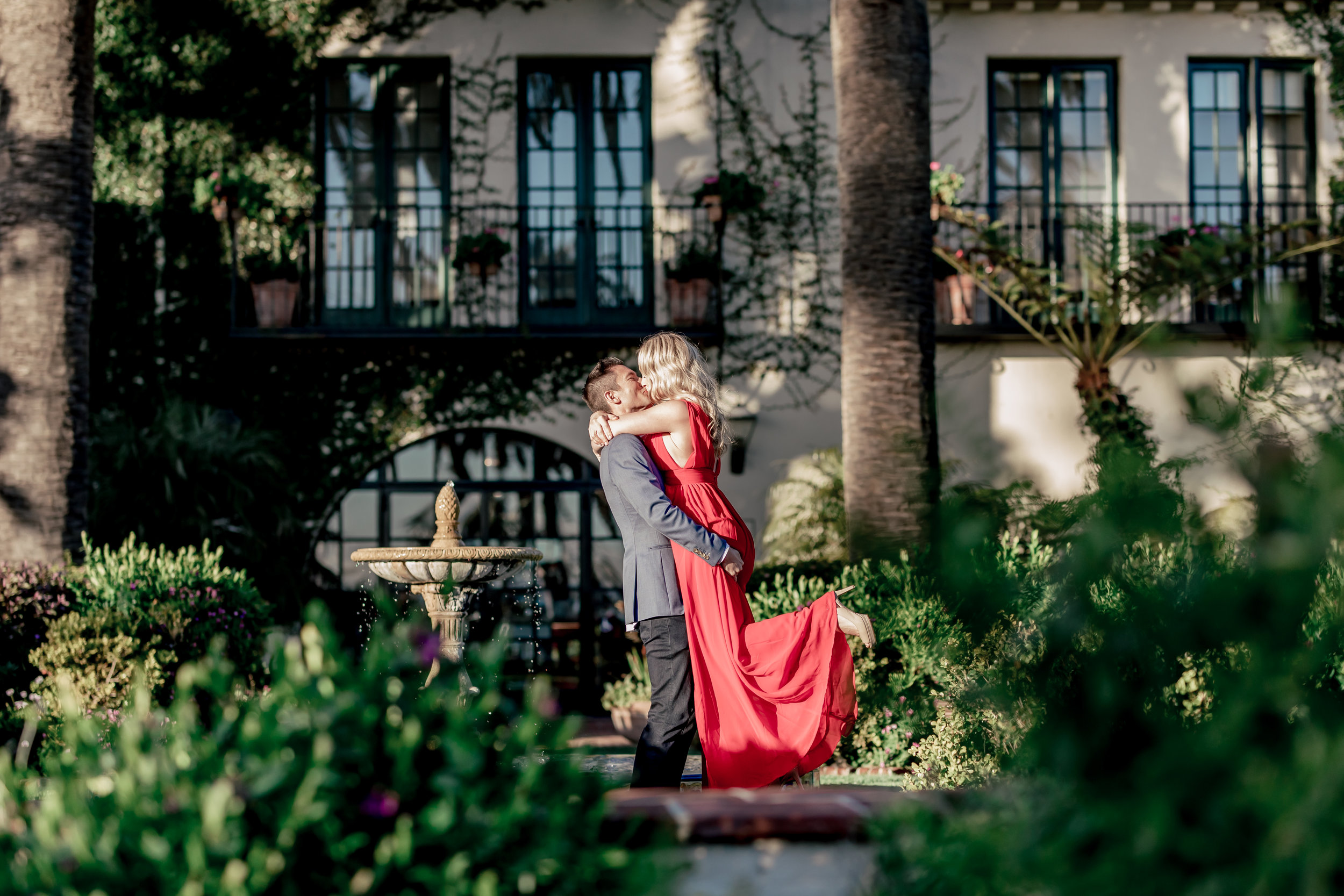 santabarbarawedding.com | Rewind Photography | Butterfly Beach | Engaged Couple In Tropical Garden