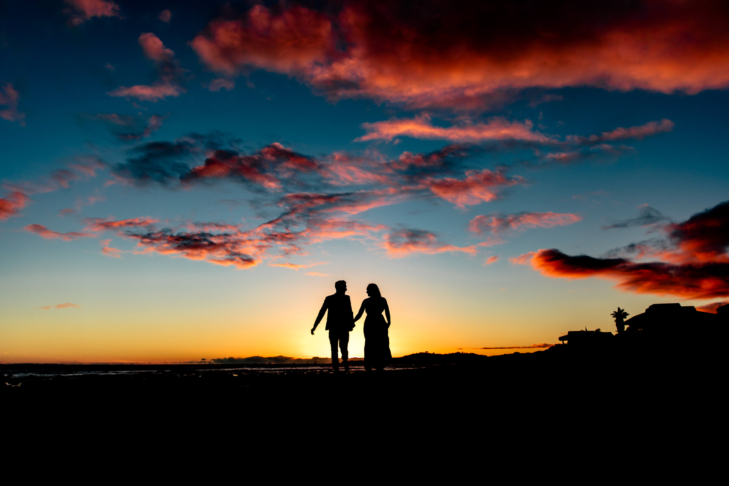 santabarbarawedding.com | Rewind Photography | Butterfly Beach | Engaged Couple on Beach at Sunset