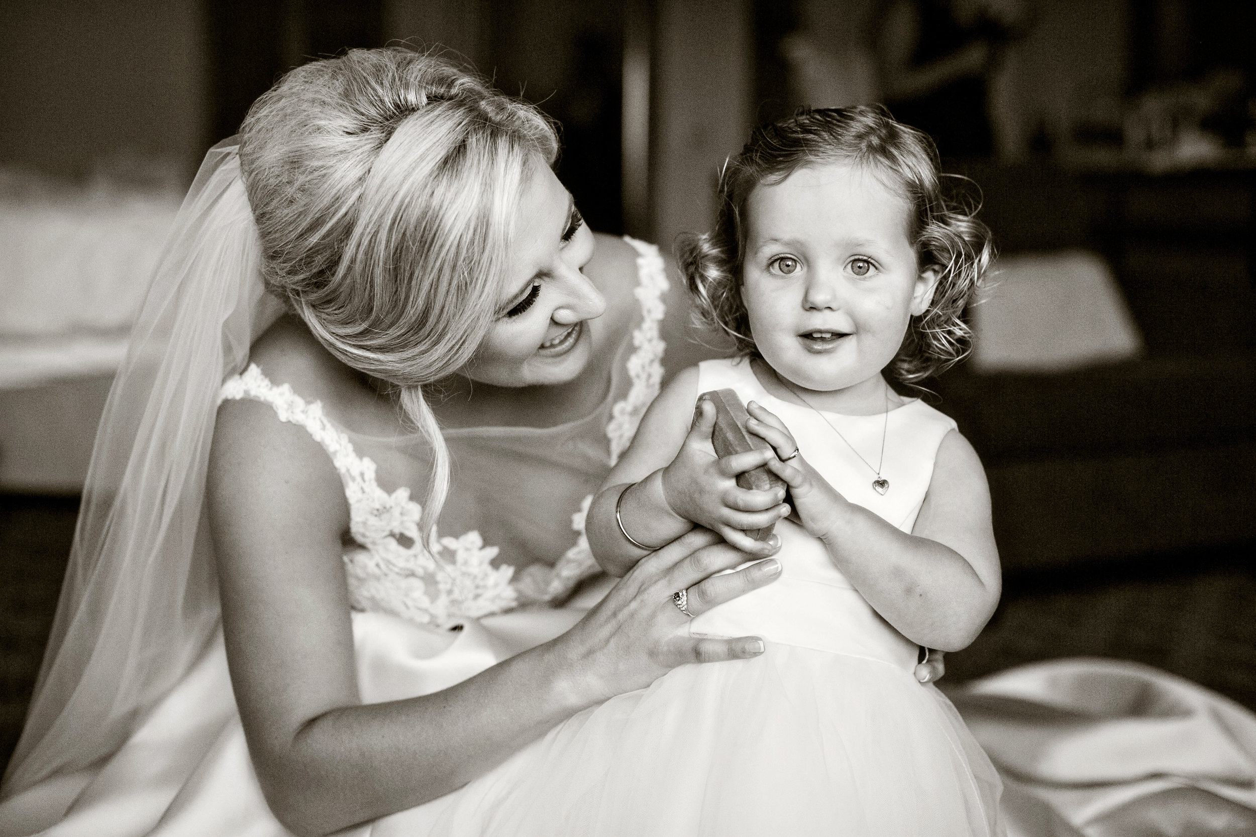 www.santabarbarawedding.com | Laurie Bailey Photography | Ojai Valley Inn | Amber Weir Wedding & Events | Luna Bella | The Bride and Flower Girl Share a Sweet Moment