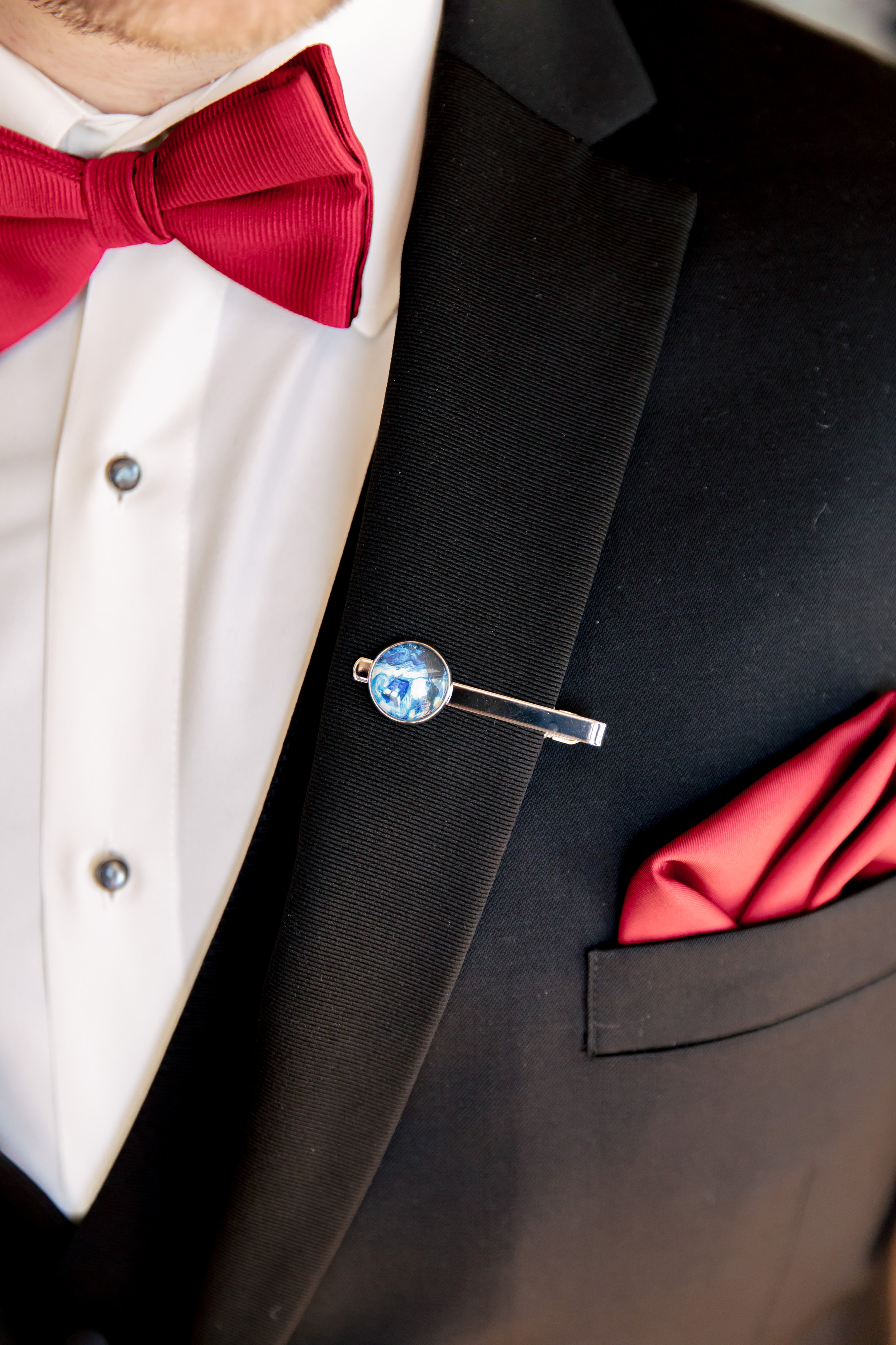 www.santabarbarawedding.com | Rewind Photography | Rockwood Women's Club | Burlap & Bordeaux | Groom's Tuxedo Close-Up and Galaxy Pin