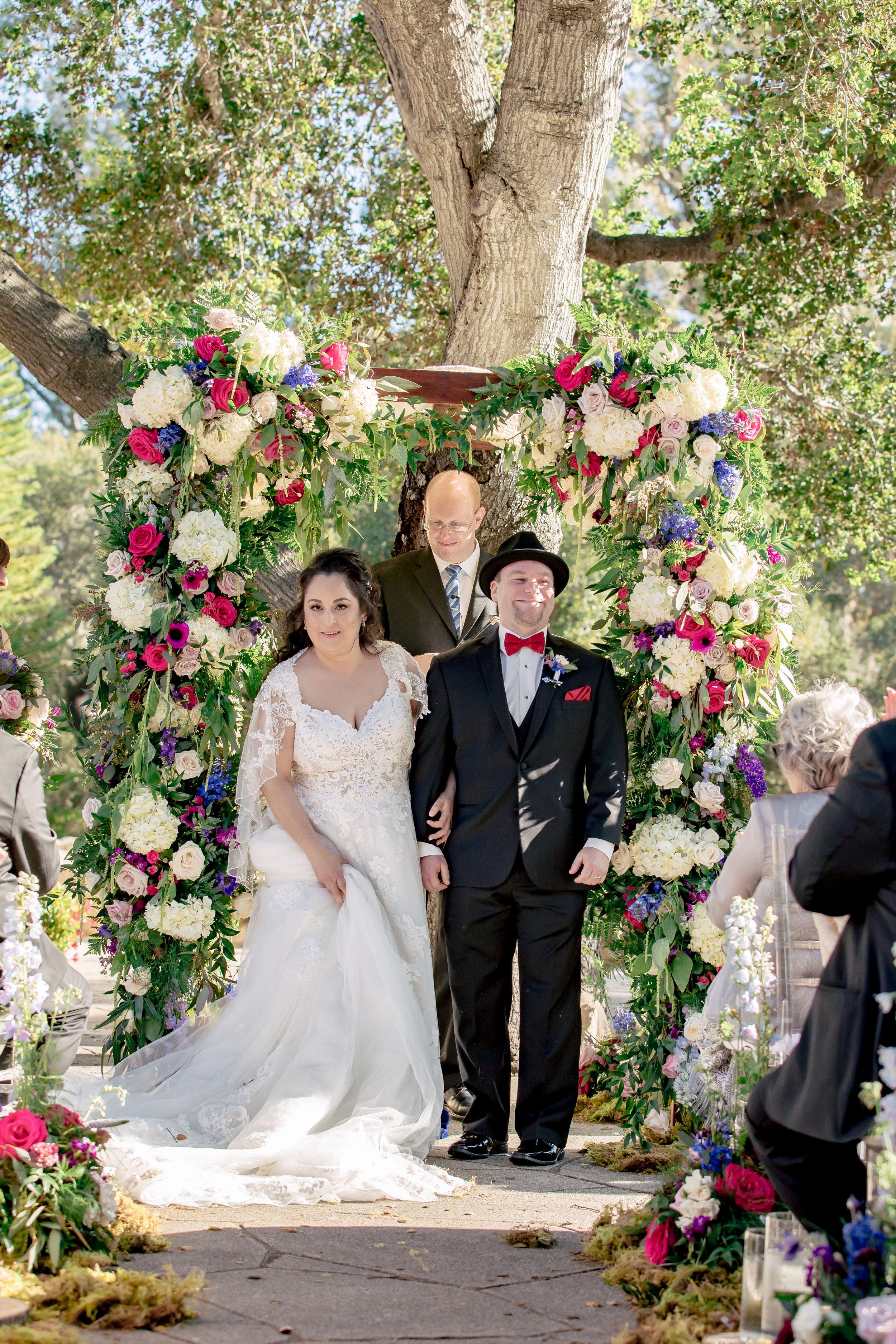 www.santabarbarawedding.com | Rewind Photography | Rockwood Women's Club | Burlap & Bordeaux | Amigo Party Rental | Couple Exit the Ceremony