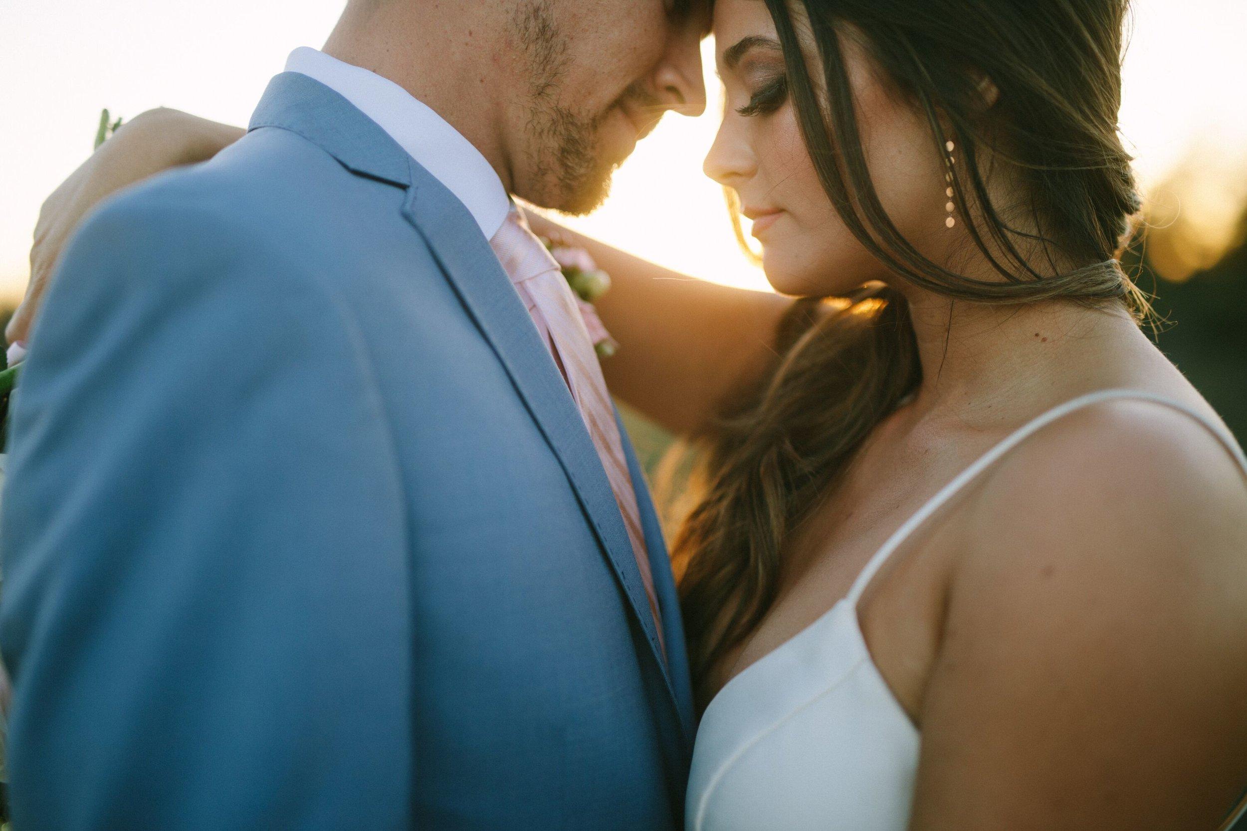 www.santabarbarawedding.com | Photographer: Patrick Ang | Venue: Rancho La Patera & Stow House | Wedding Planner: Elyse Rowen of Elyse Events | Bride and Groom Sunset Closeup