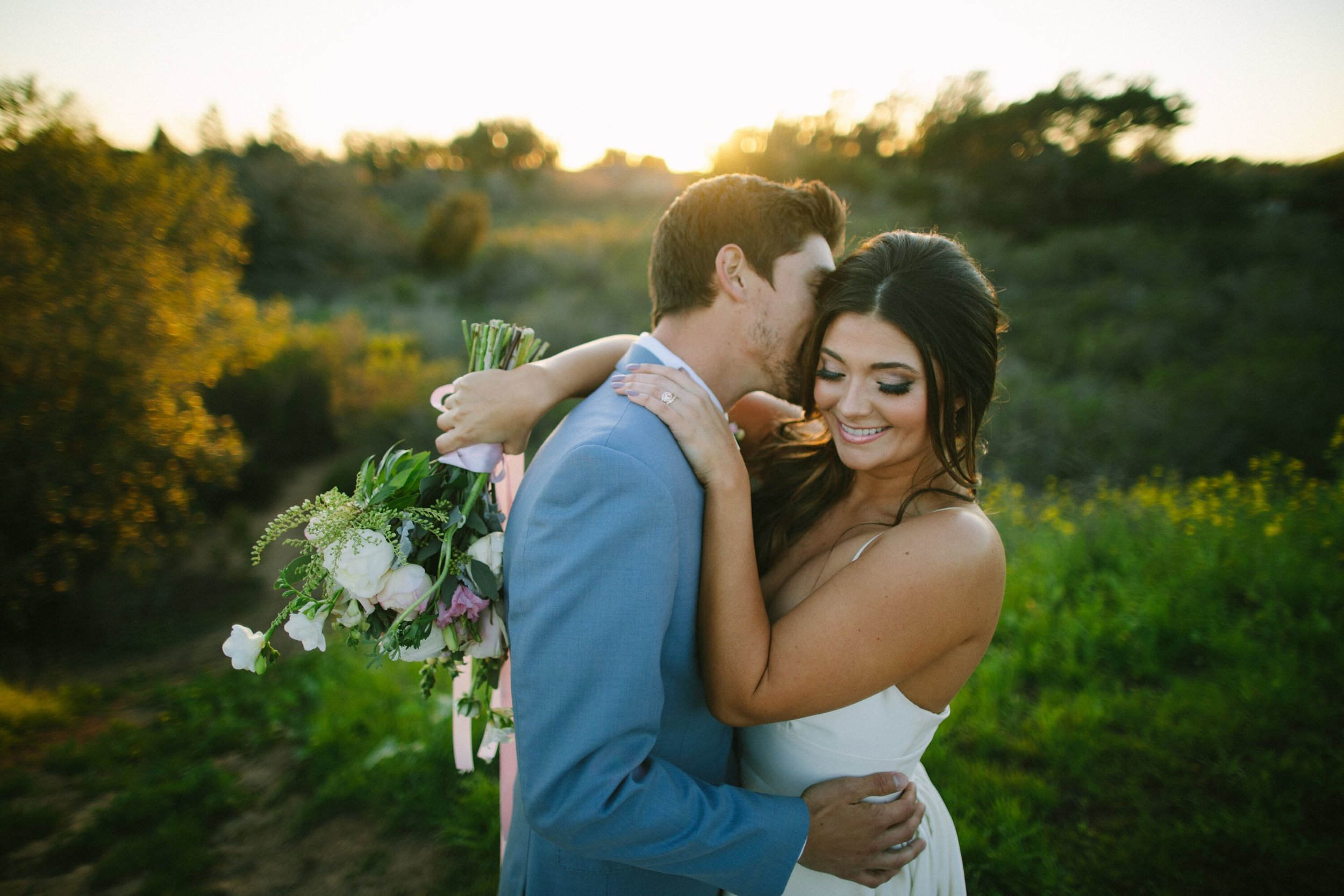 www.santabarbarawedding.com | Photographer: Patrick Ang | Venue: Rancho La Patera & Stow House | Wedding Planner: Elyse Rowen of Elyse Events | Bride and Groom Bouquet and Kiss