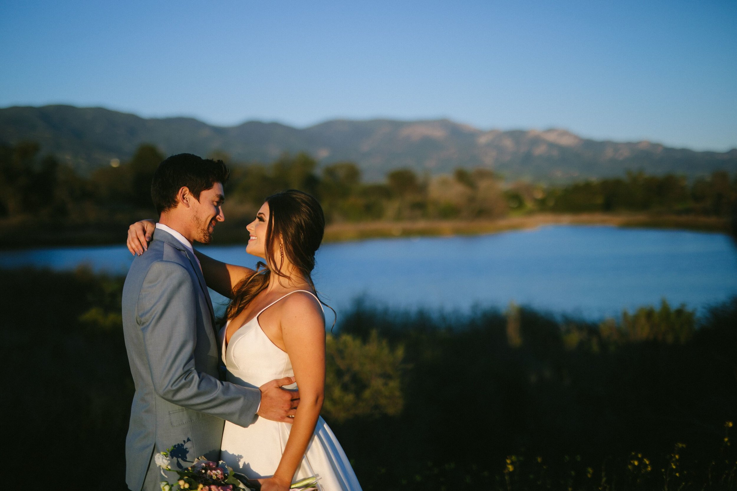 www.santabarbarawedding.com | Photographer: Patrick Ang | Venue: Rancho La Patera & Stow House | Wedding Planner: Elyse Rowen of Elyse Events | Bride and Groom Overlooking Water