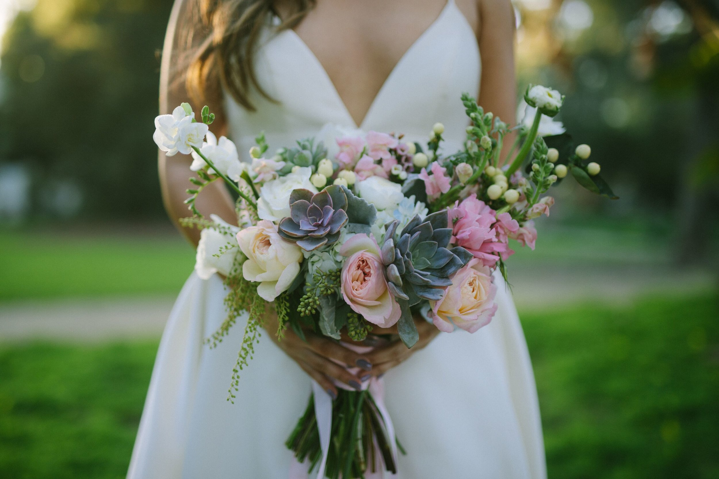 www.santabarbarawedding.com | Photographer: Patrick Ang of Forever Rooted Films | Venue: Rancho La Patera & Stow House | Wedding Planner: Elyse Rowen of Elyse Events | Bride Holding Bouquet