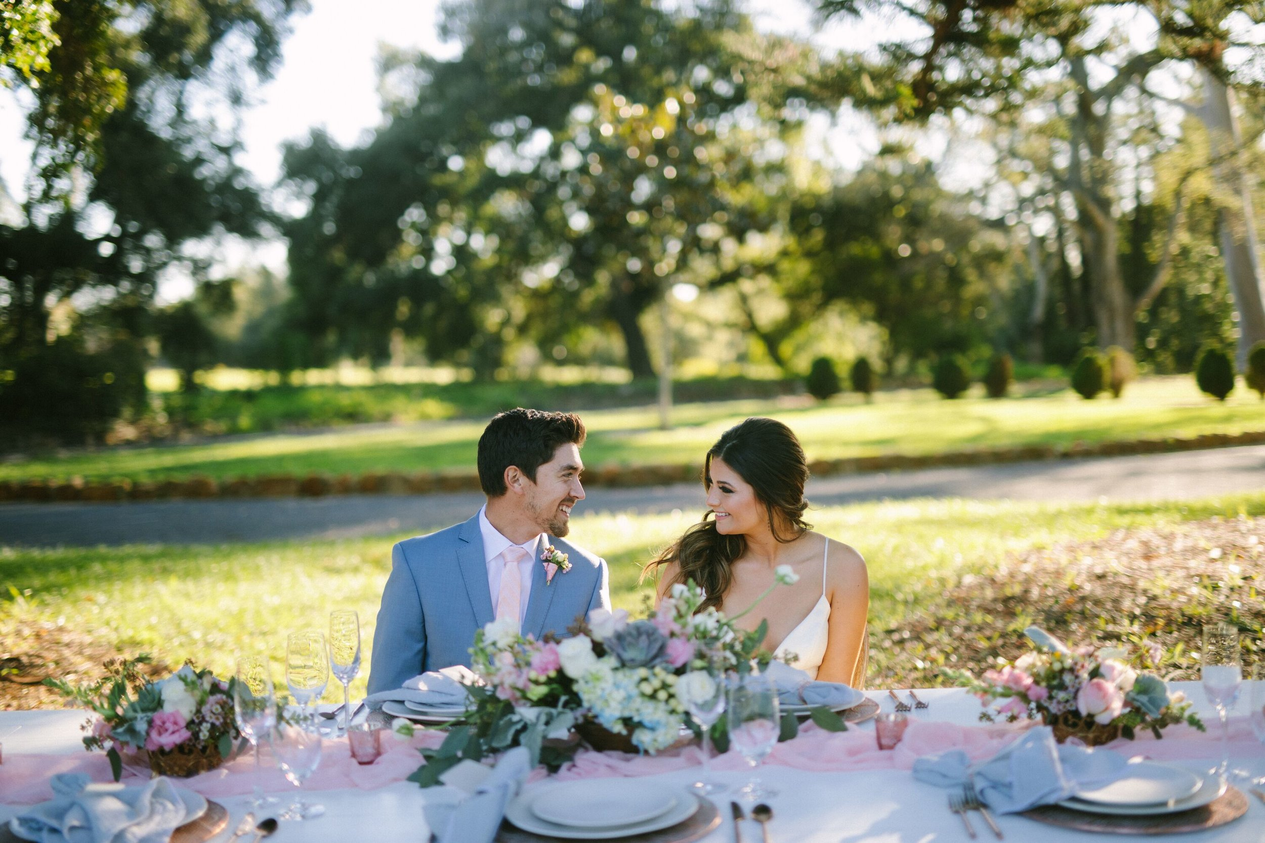 www.santabarbarawedding.com | Photographer: Patrick Ang | Venue: Rancho La Patera & Stow House | Wedding Planner: Elyse Rowen of Elyse Events | Bride and Groom at Table