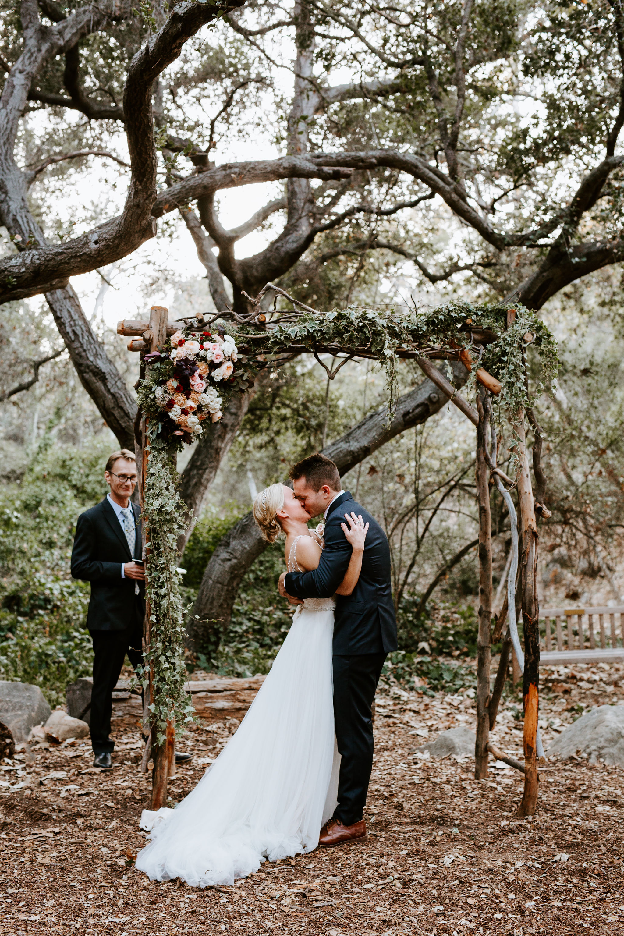 www.santabarbarawedding.com | Geoff and Lyndsi Photography | Santa Barbara Museum of Natural History | Jamie Mangone of LuJane Events | Topa Flora | Bride and Groom First Kiss