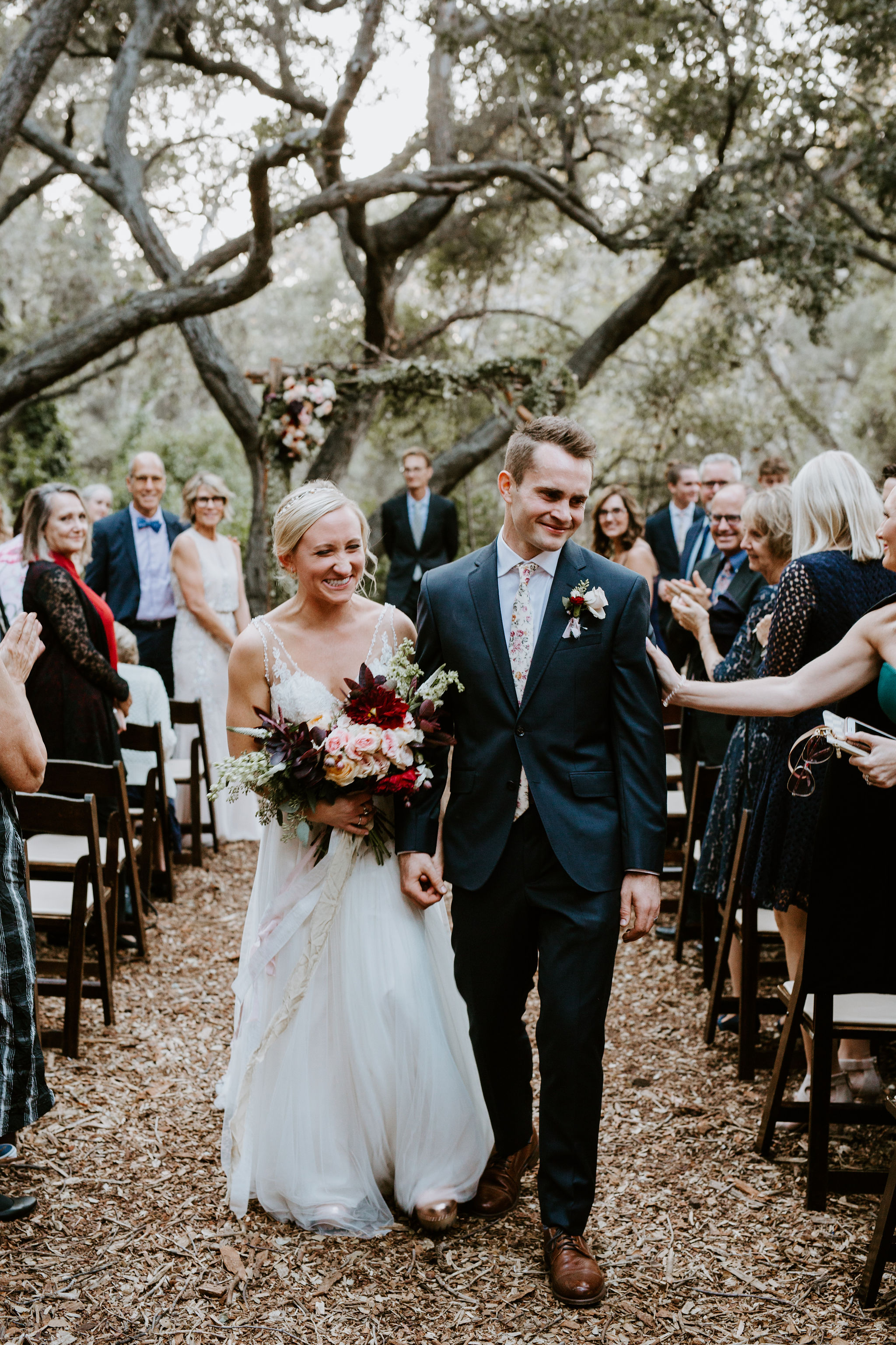 www.santabarbarawedding.com | Geoff and Lyndsi Photography | Santa Barbara Museum of Natural History | Jamie Mangone of LuJane Events | Topa Flora | Bride and Groom Leave Ceremony