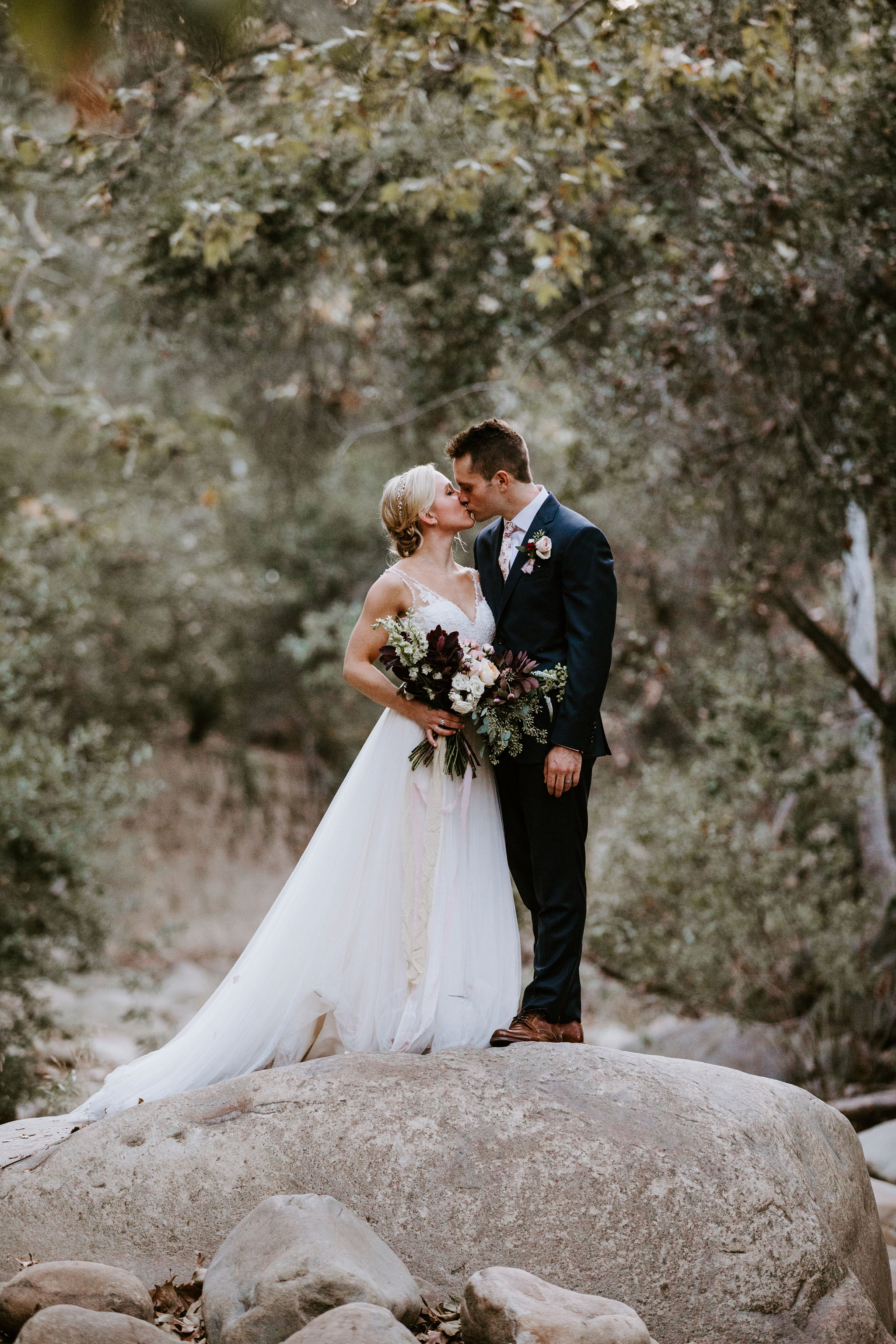 www.santabarbarawedding.com | Geoff and Lyndsi Photography | Santa Barbara Museum of Natural History | Jamie Mangone of LuJane Events | Topa Flora | Bride and Groom Share a Kiss
