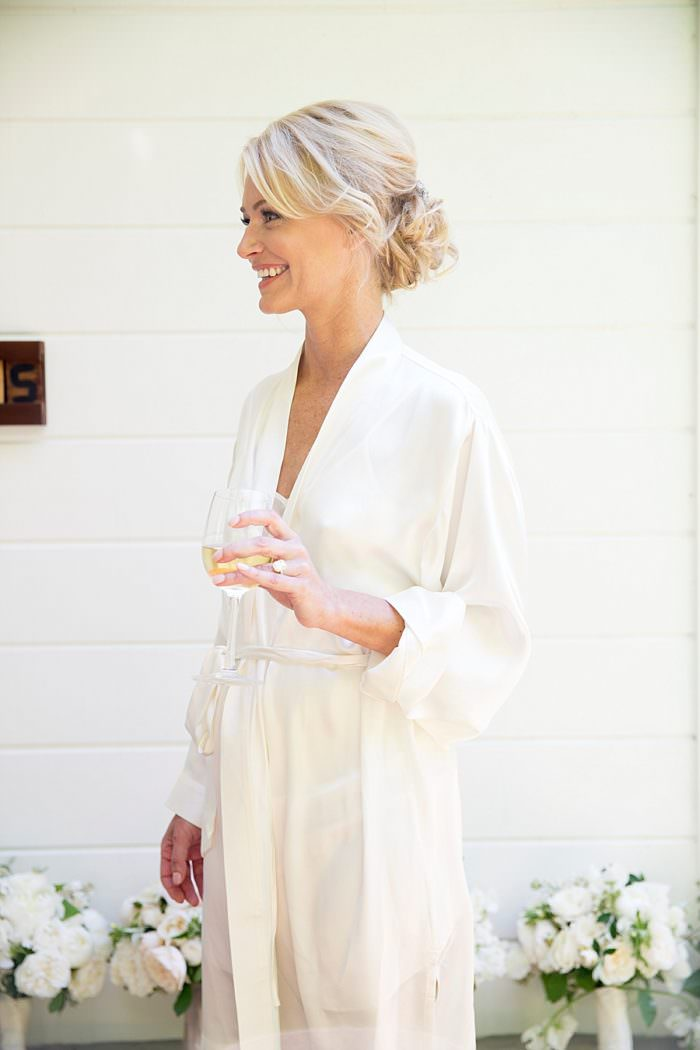 www.santabarbarawedding.com | Kristen Beinke | San Ysidro Ranch | Alexandra Kolendrianos | Shine Blow Dry Bar Montecito | Bride Drinks Wine Before the Ceremony