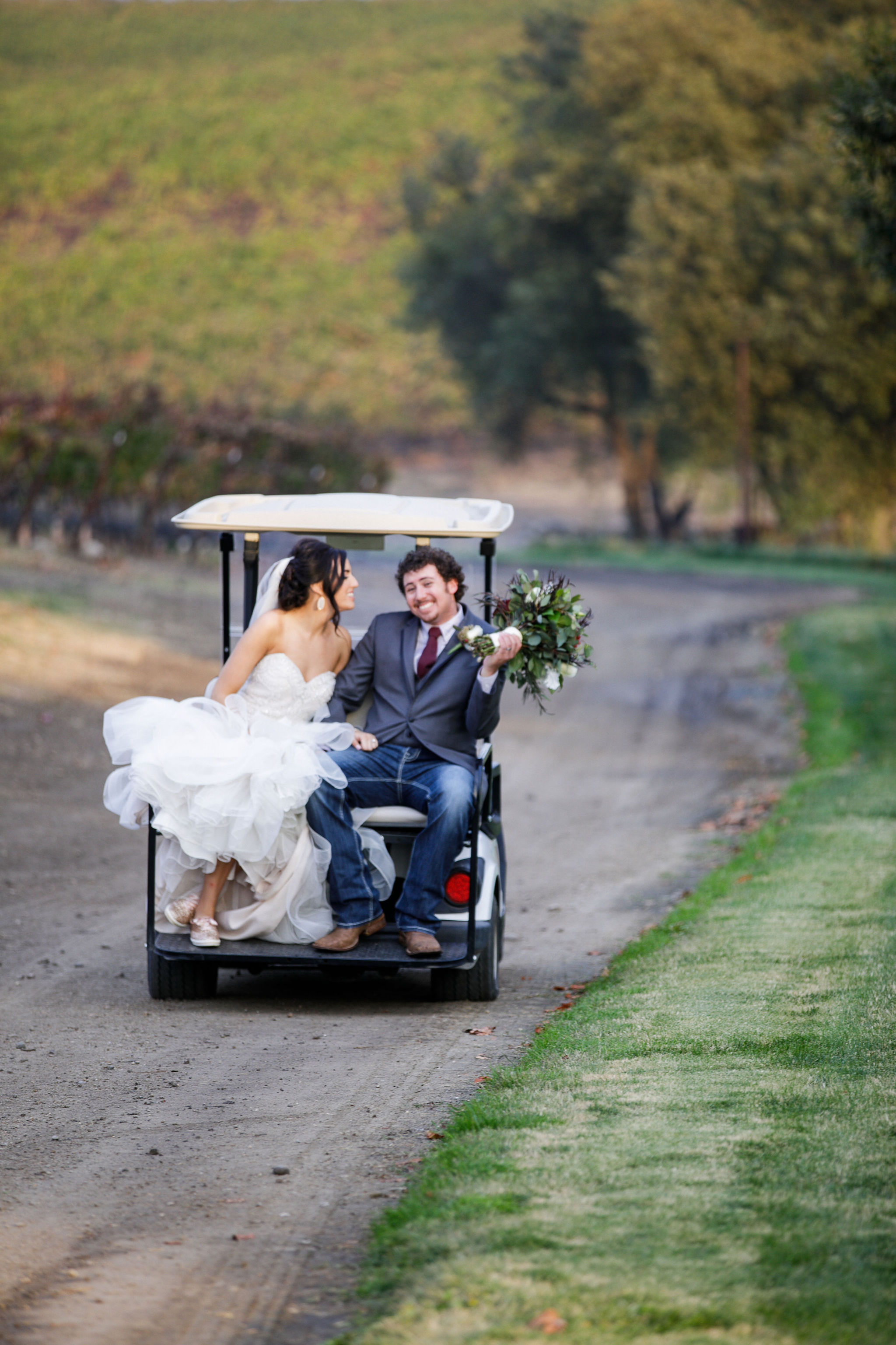 www.santabarbarawedding.com | Kiel Rucker | Greengate Ranch | Kramer Events | Bianca's Bridal | De La Fleur Flowers | Bride and Groom Ride Away on Golf Cart