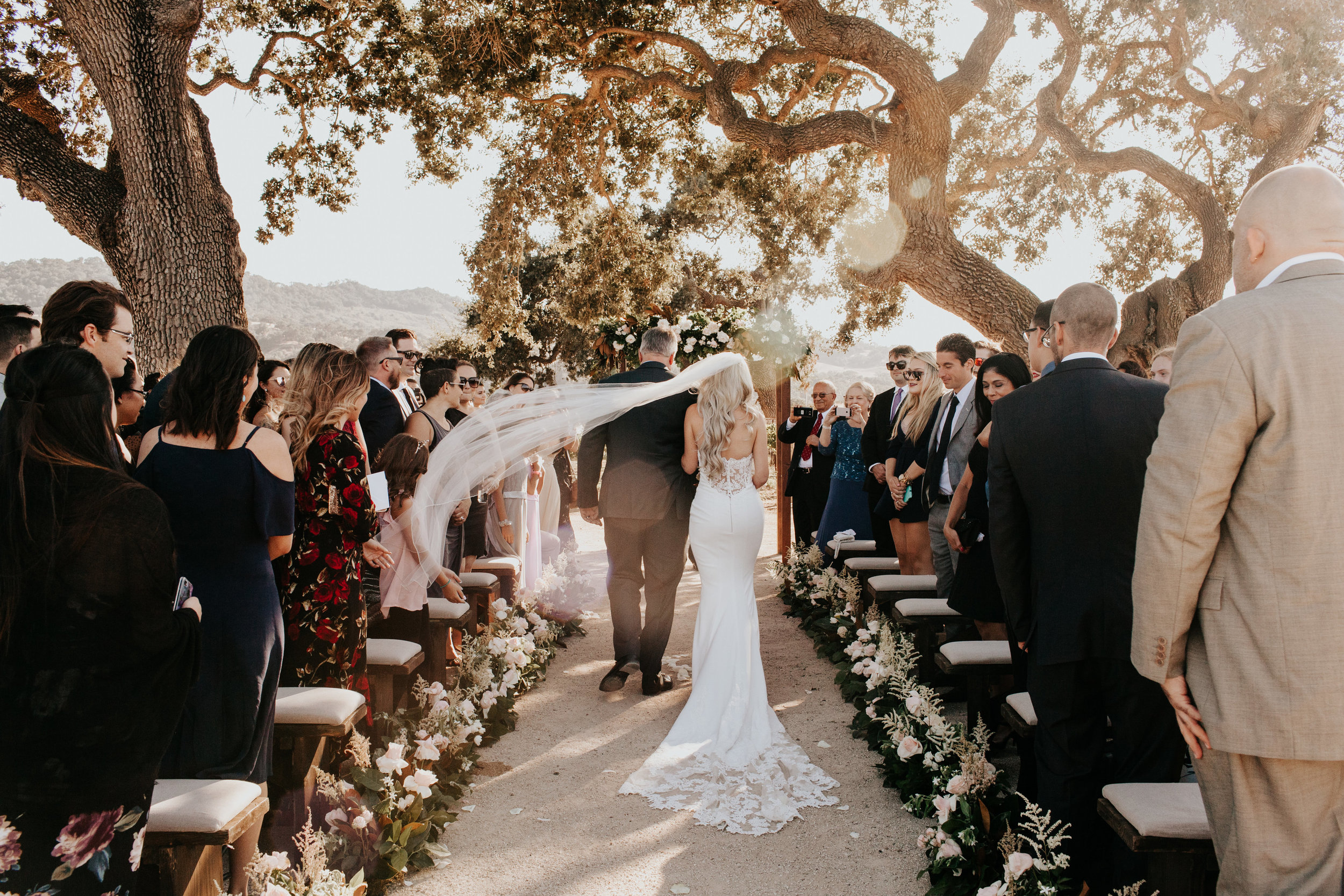 www.santabarbarawedding.com | Alexandria Monette Photography | Sunstone Villa | Soleil Events | Anna le Pley Taylor Flowers | Town and Country Event Rentals | Bride Walks into Ceremony