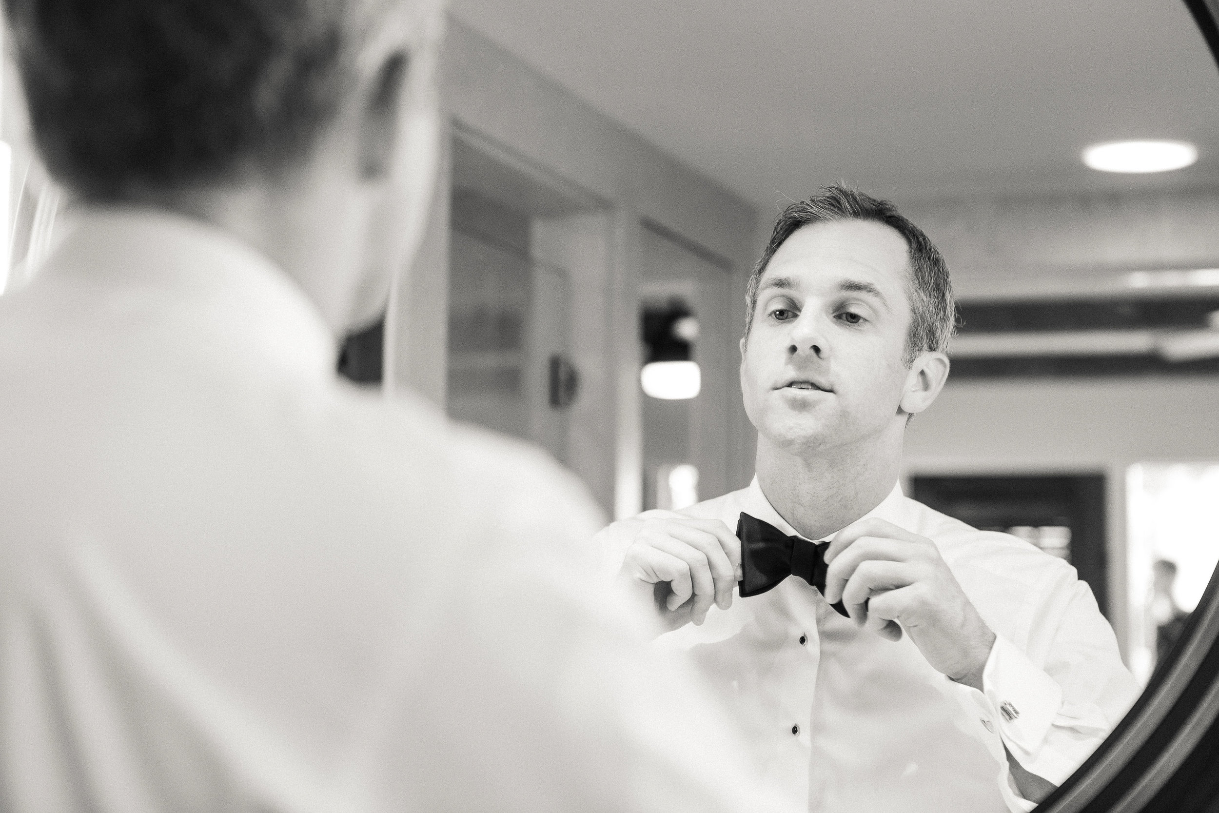 www.santabarbarawedding.com   Kiel Rucker Photography   The Ritz Carlton Bacara   Event of the Season   Groom Straightening His Bowtie