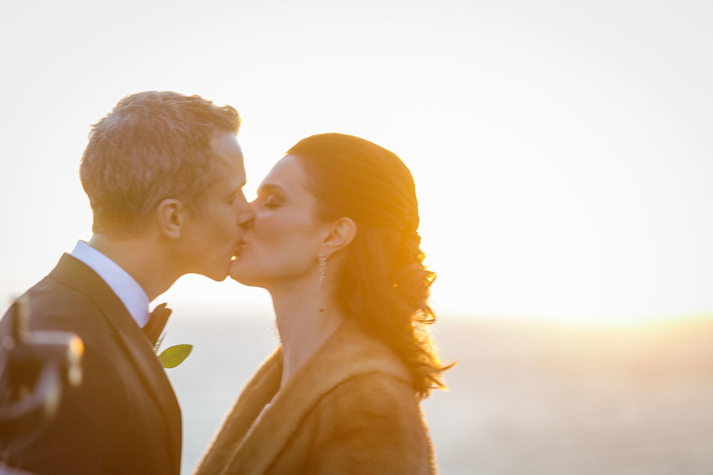 www.santabarbarawedding.com   Kiel Rucker Photography   The Ritz Carlton Bacara   Event of the Season   Cody Floral Design   A Kiss at Sunset
