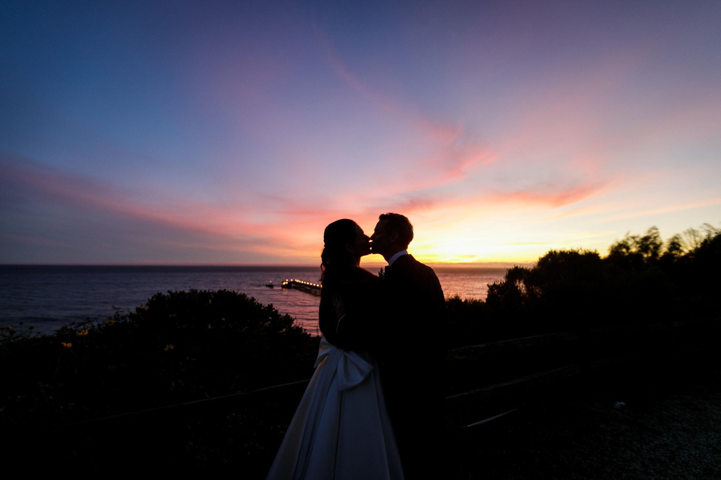 www.santabarbarawedding.com   Kiel Rucker Photography   The Ritz Carlton Bacara   Event of the Season   Sareh Nouri   Couple Kiss at Sunset