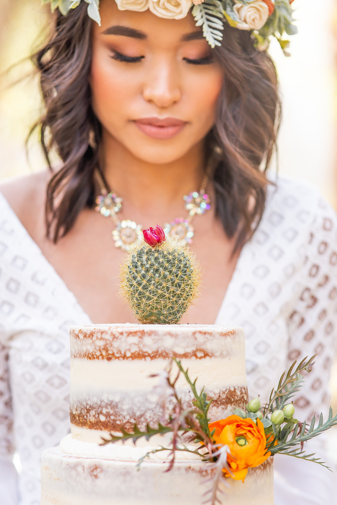www.santabarbarawedding.com   Staci and Michael Photography   Montana de Oro State Park   EverAfter Wood Floral   Makeup by Madisen Wickliffe   Bri's Sweet Treats   Bride holding wedding cake