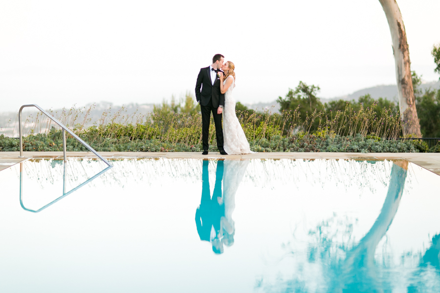 www.santabarbarawedding.com | Allyson Magda Photography | Belmond El Encanto | Events by M and M | Bella Vista Designs | Kissing by the Pool