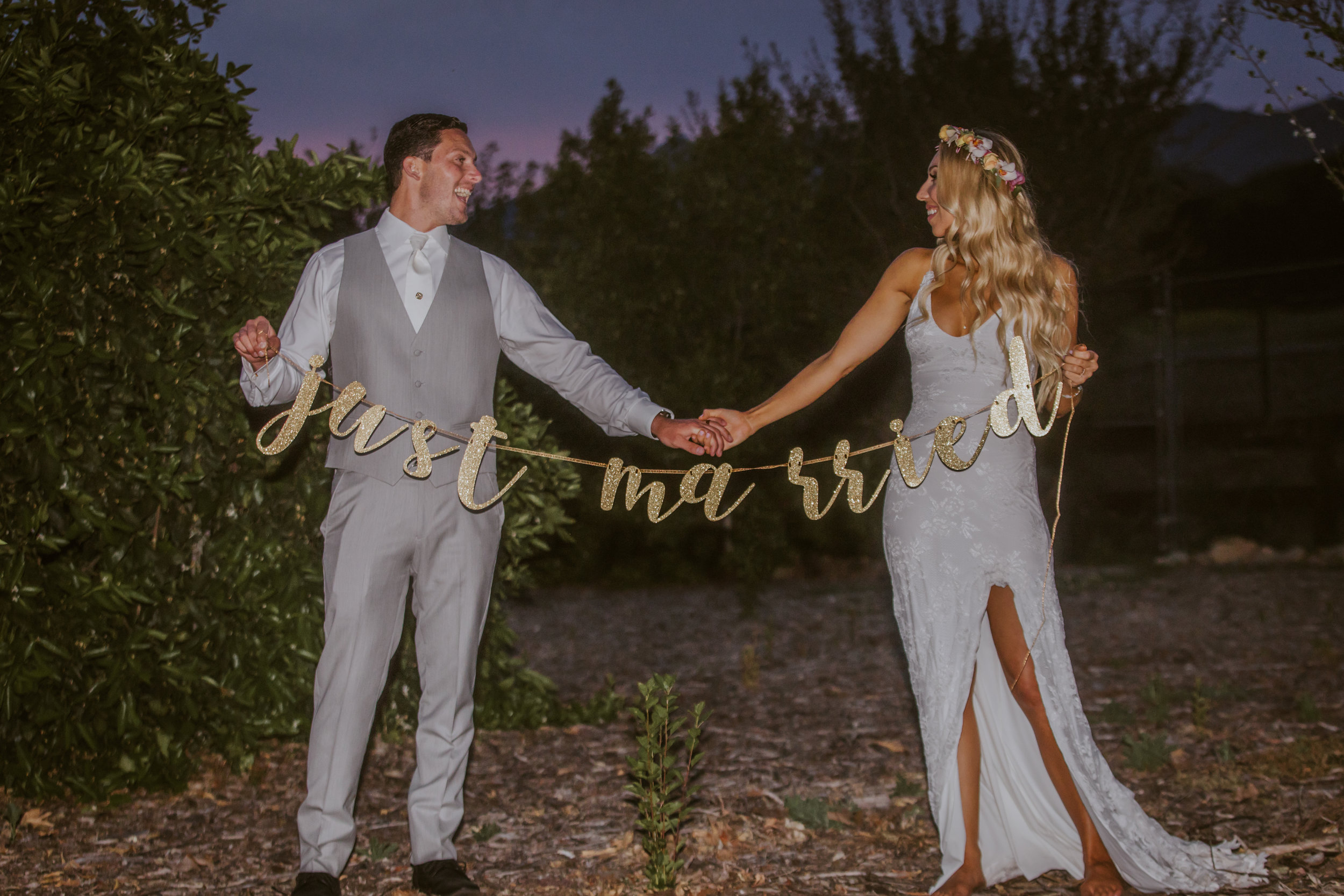 www.santabarbarawedding.com | Burgundy Blue | Ventura Rentals | Fleur De Rye | Paradise Music Photo Booth | Bride and Groom with Just Married Sign