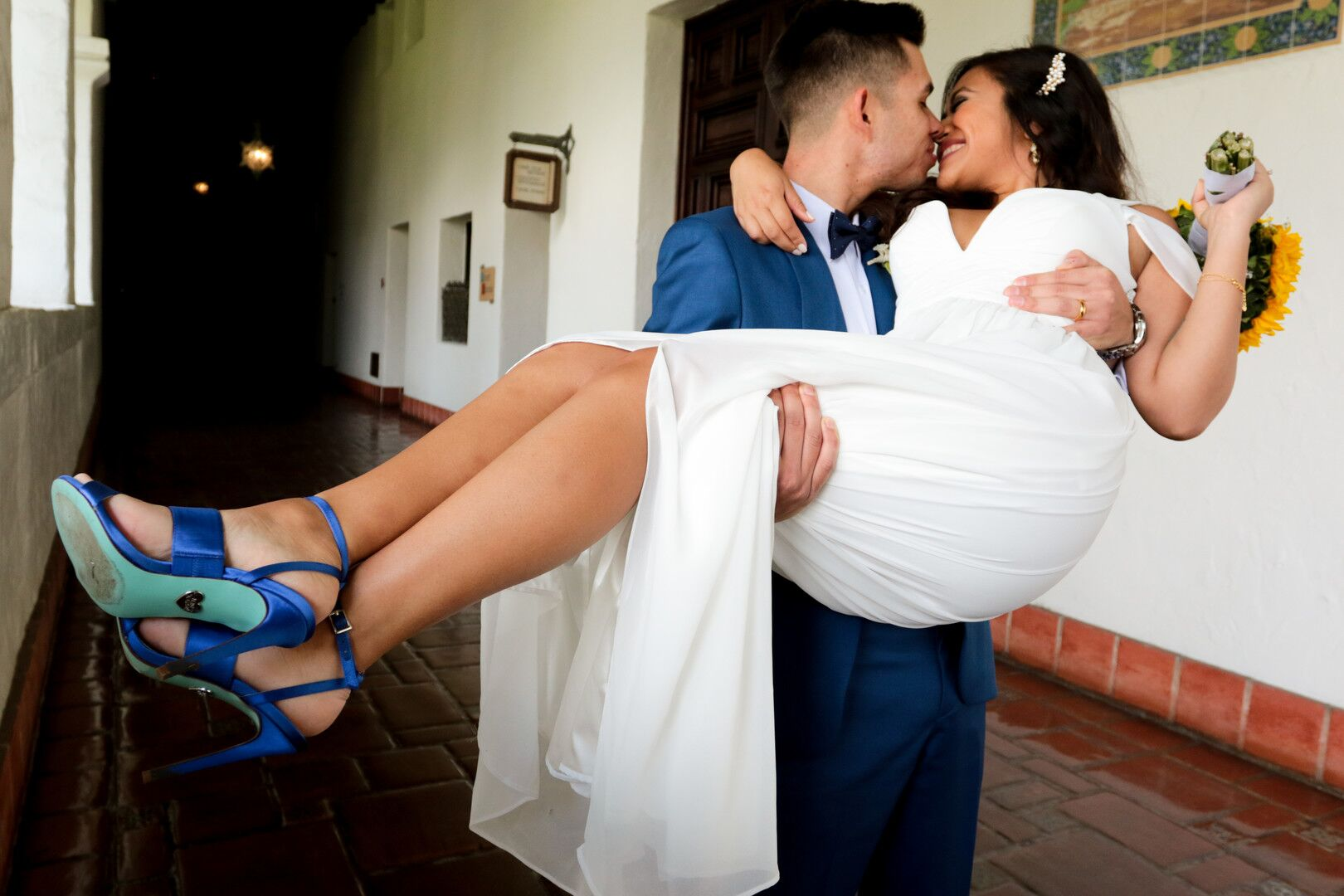 www.santabarbaraweddings.com | Photographer: Trista Maja Photography | Venue: Santa Barbara Courthouse | Wedding Dress: Lulus | Hair: Legends Hair | Groom Carrying Bride