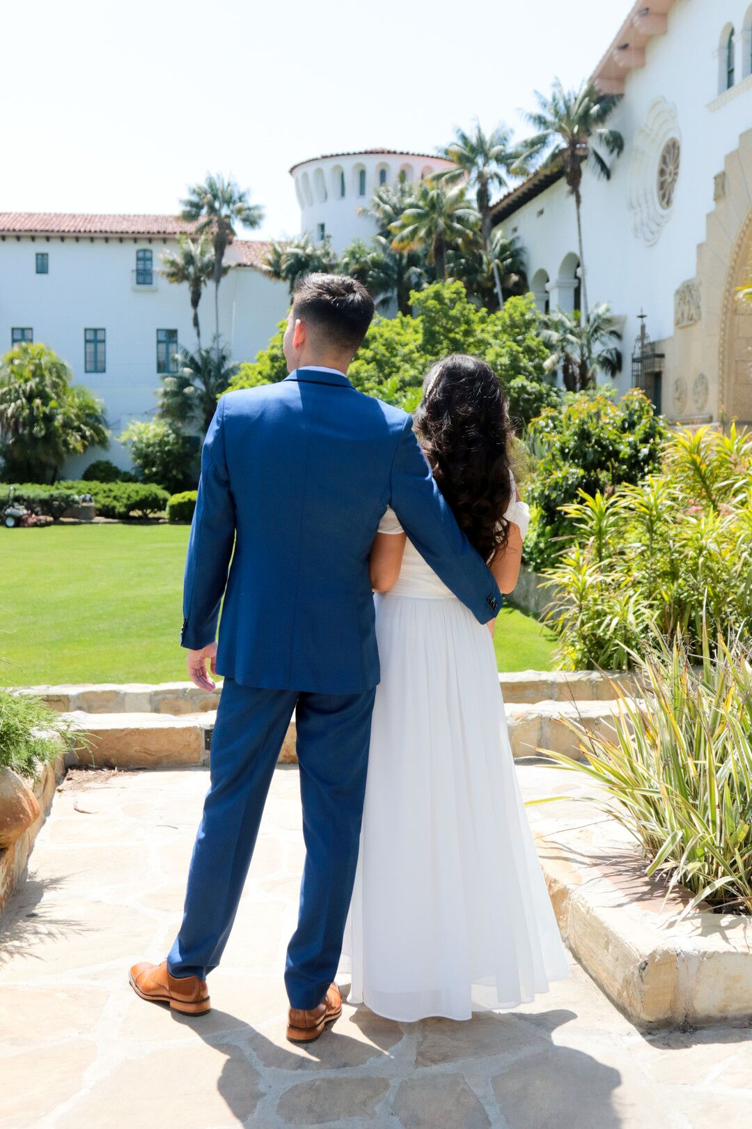 www.santabarbaraweddings.com | Photographer: Trista Maja Photography | Venue: Santa Barbara Courthouse | Wedding Dress: Lulus | Hair: Legends Hair |  Bride and Groom Embrace