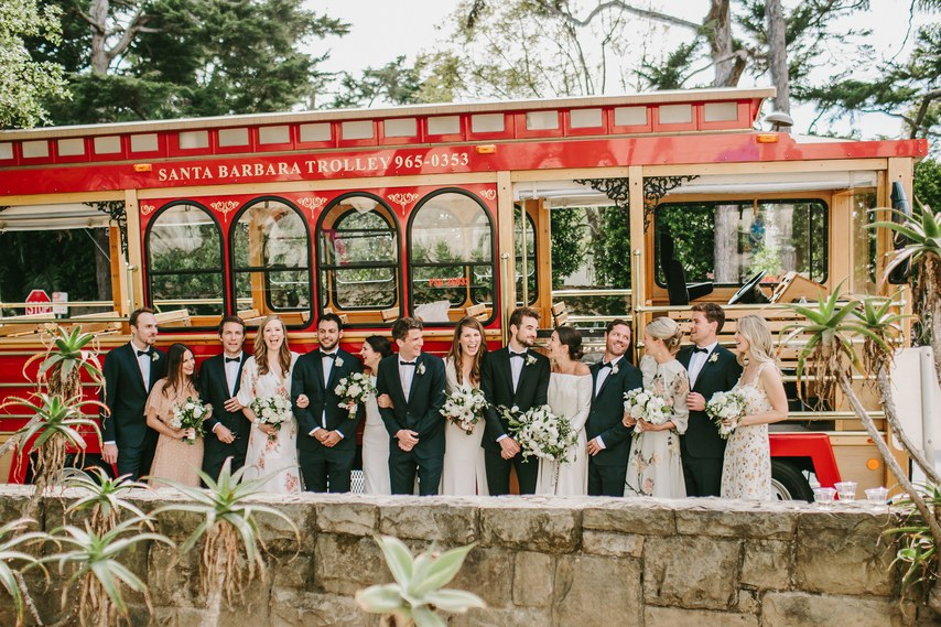 www.santabarbarawedding.com | WildWhim Design + Photography | Our Lady of Mount Carmel | Ann Johnson Events | Bloom Floral and Foliage | Santa Barbara Trolley | Bridal Party With Trolley