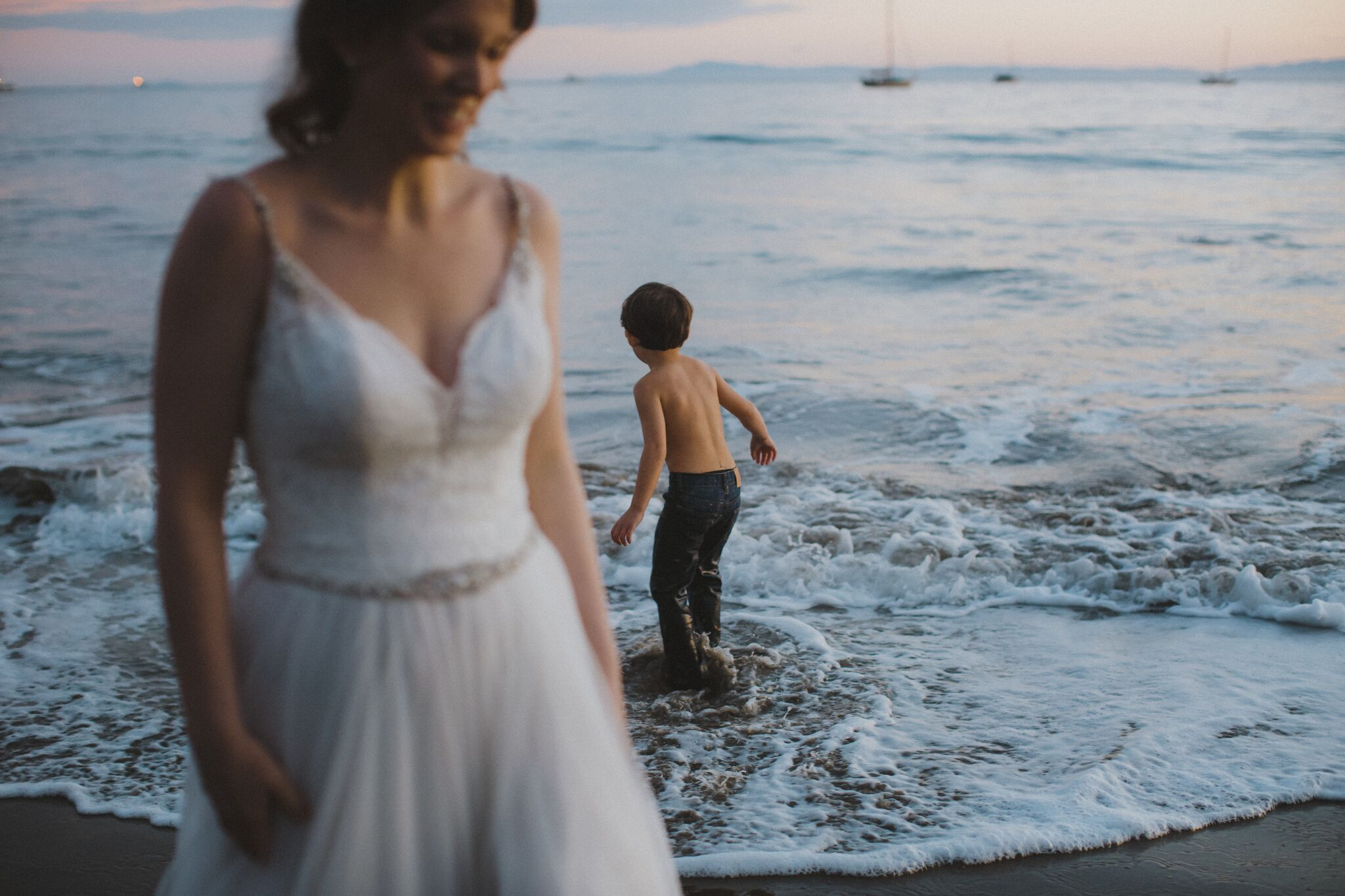 www.santabarbawedding.com | Venue: Santa Barbara Courthouse | Photography: Ryanne Bee Photography | Officiant: Santa Barbara Classic Weddings | Bride and Child Playing in the Sea