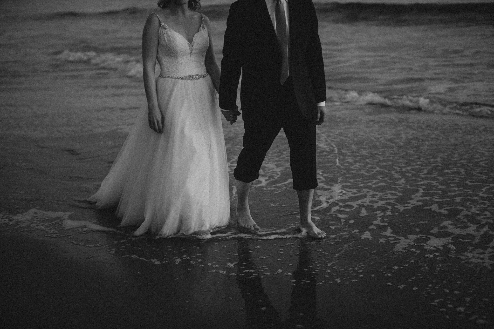 www.santabarbawedding.com | Venue: Santa Barbara Courthouse | Photography: Ryanne Bee Photography | Officiant: Santa Barbara Classic Weddings | Bride and Groom Walking Barefoot in Ocean