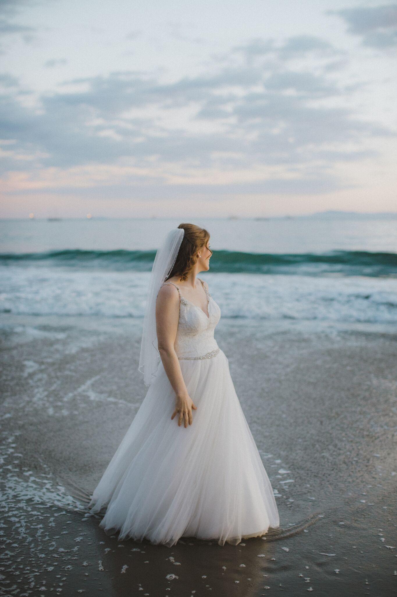 www.santabarbawedding.com | Venue: Santa Barbara Courthouse | Photography: Ryanne Bee Photography | Officiant: Santa Barbara Classic Weddings | Bride Looking at the Ocean
