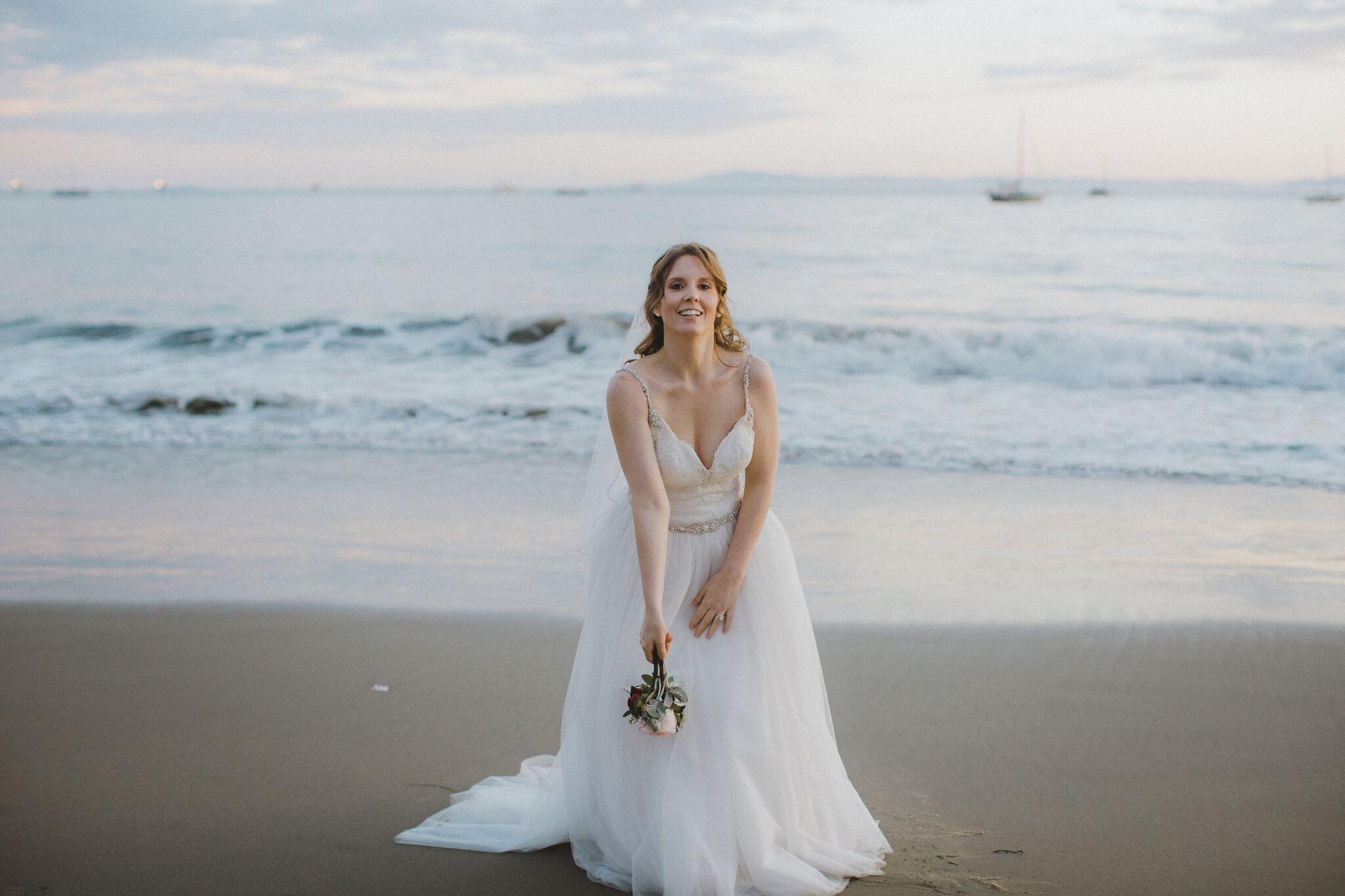 www.santabarbawedding.com | Venue: Santa Barbara Courthouse | Photography: Ryanne Bee Photography | Officiant: Santa Barbara Classic Weddings | Bride Tossing Bouquet into the Ocean